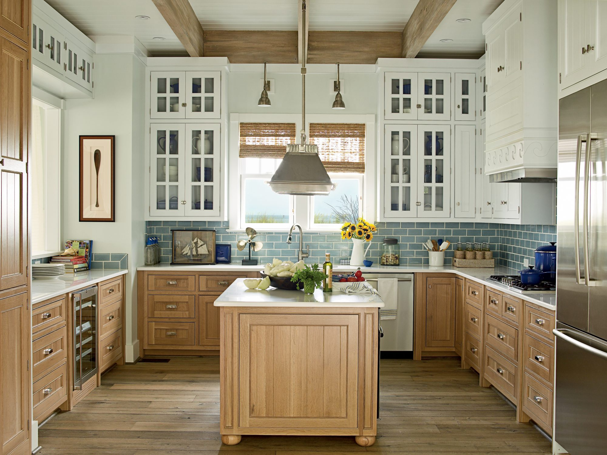 White paint and glass doors on the upper cabinets brighten the kitchen in our 2011 Showhouse kitchen in Norfolk, Virginia, while the polyurethane finish on the cabinets below stands up to wear and tear without chipping. The deep blue recycled ceramic-tile