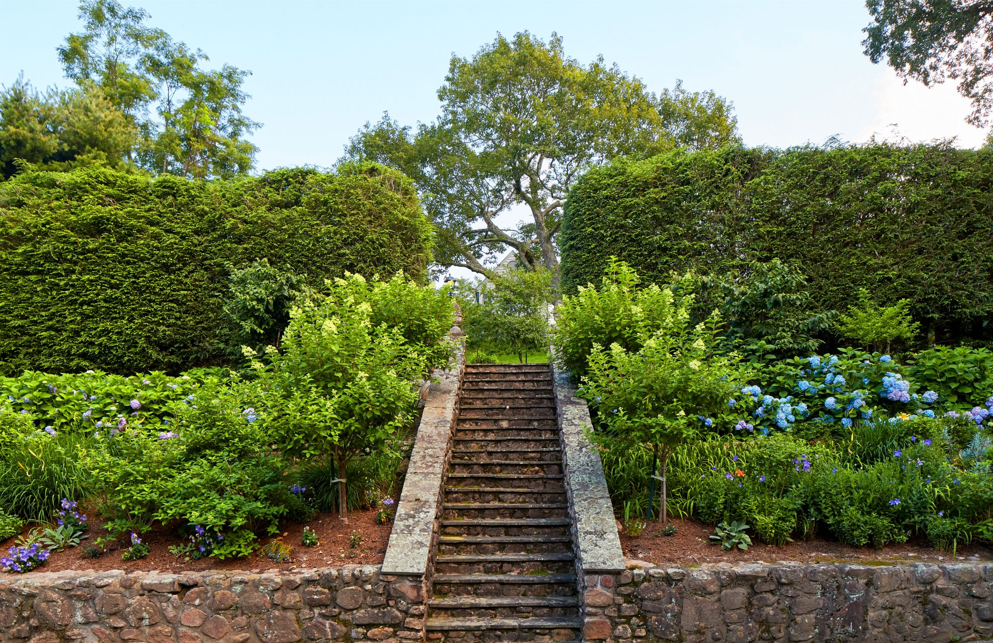 Brick Garden Stairs with Blooming Hydrangeas at 1929 Mountain House in North Carolina