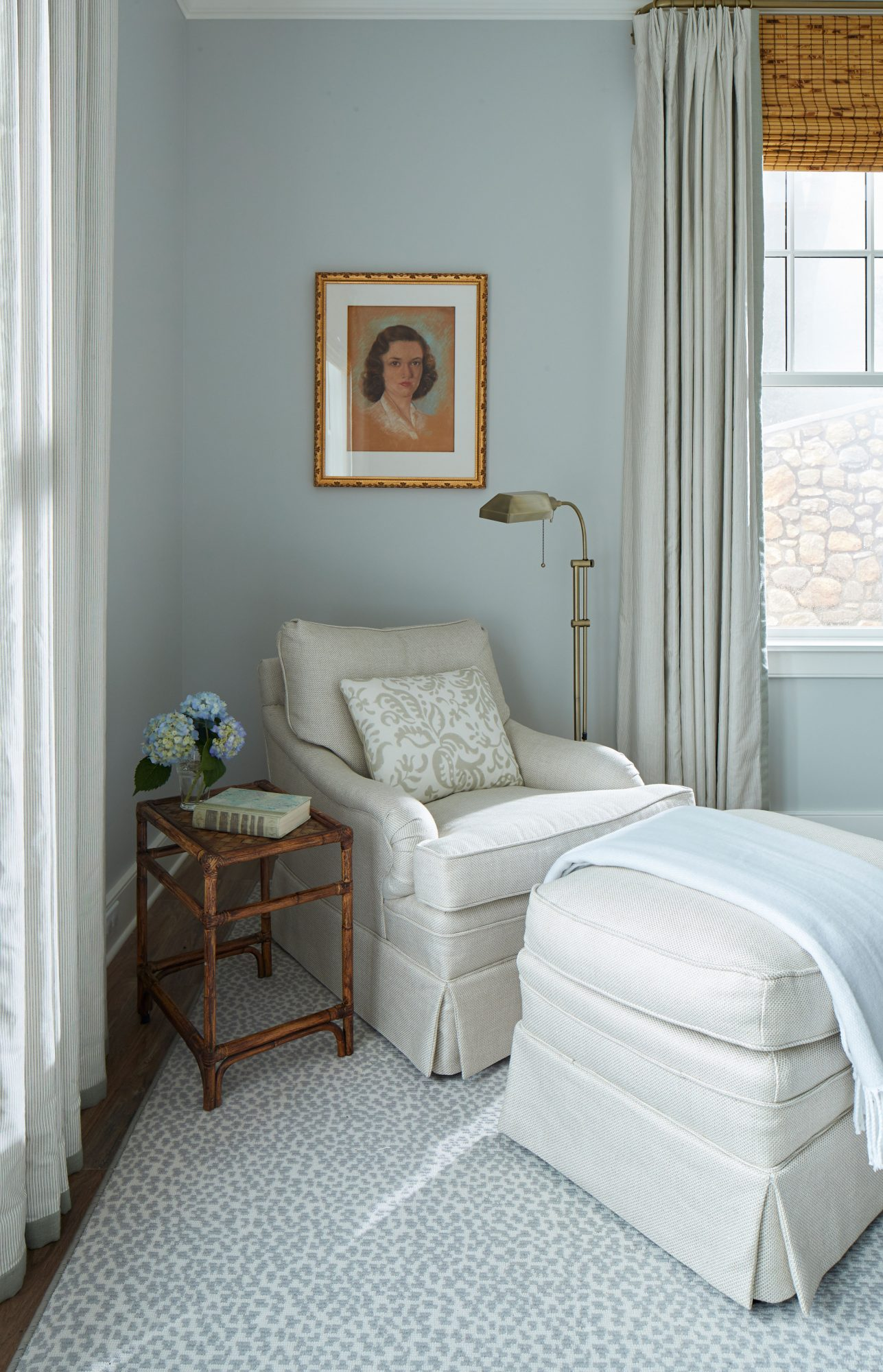 Cozy Chair in Master Bedroom with Family Portrait Above