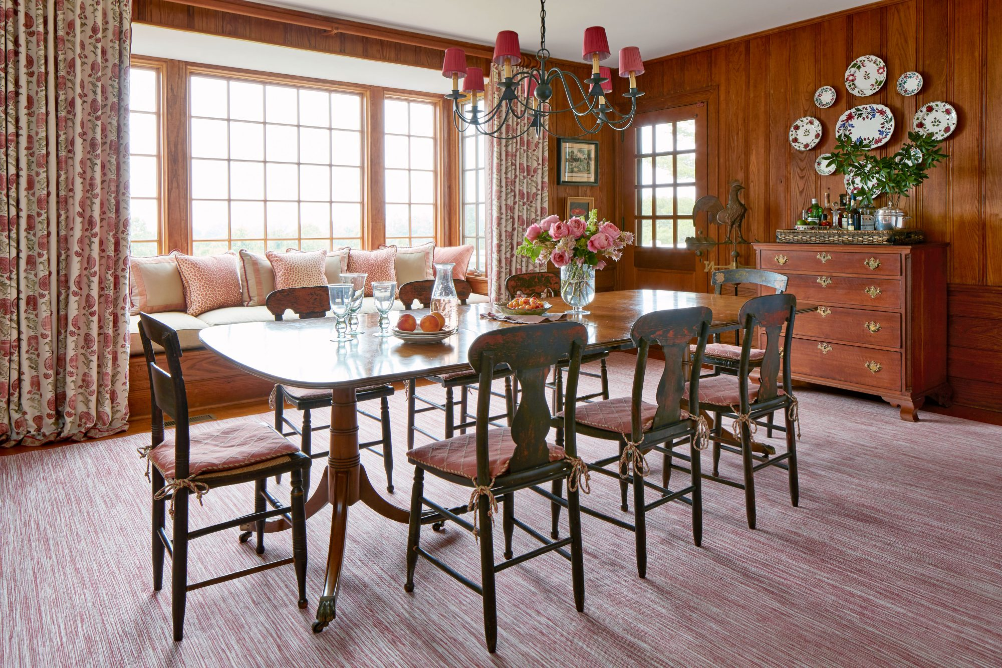 1929 Mountain House Dining Room with Wood Paneled Walls and Large Window Seat