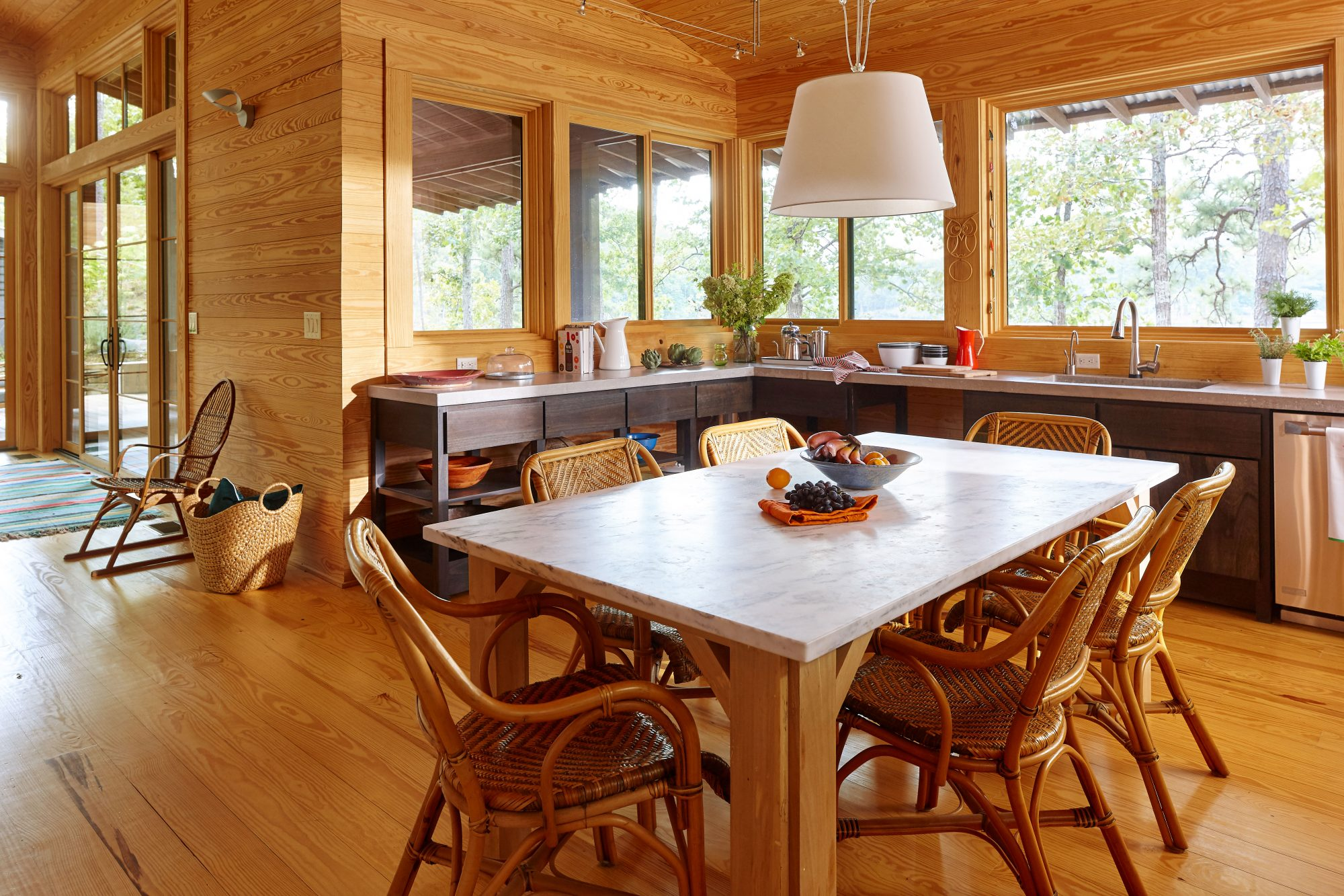 Modern Wood Paneled Lake House Kitchen with Marble Top Kitchen Table