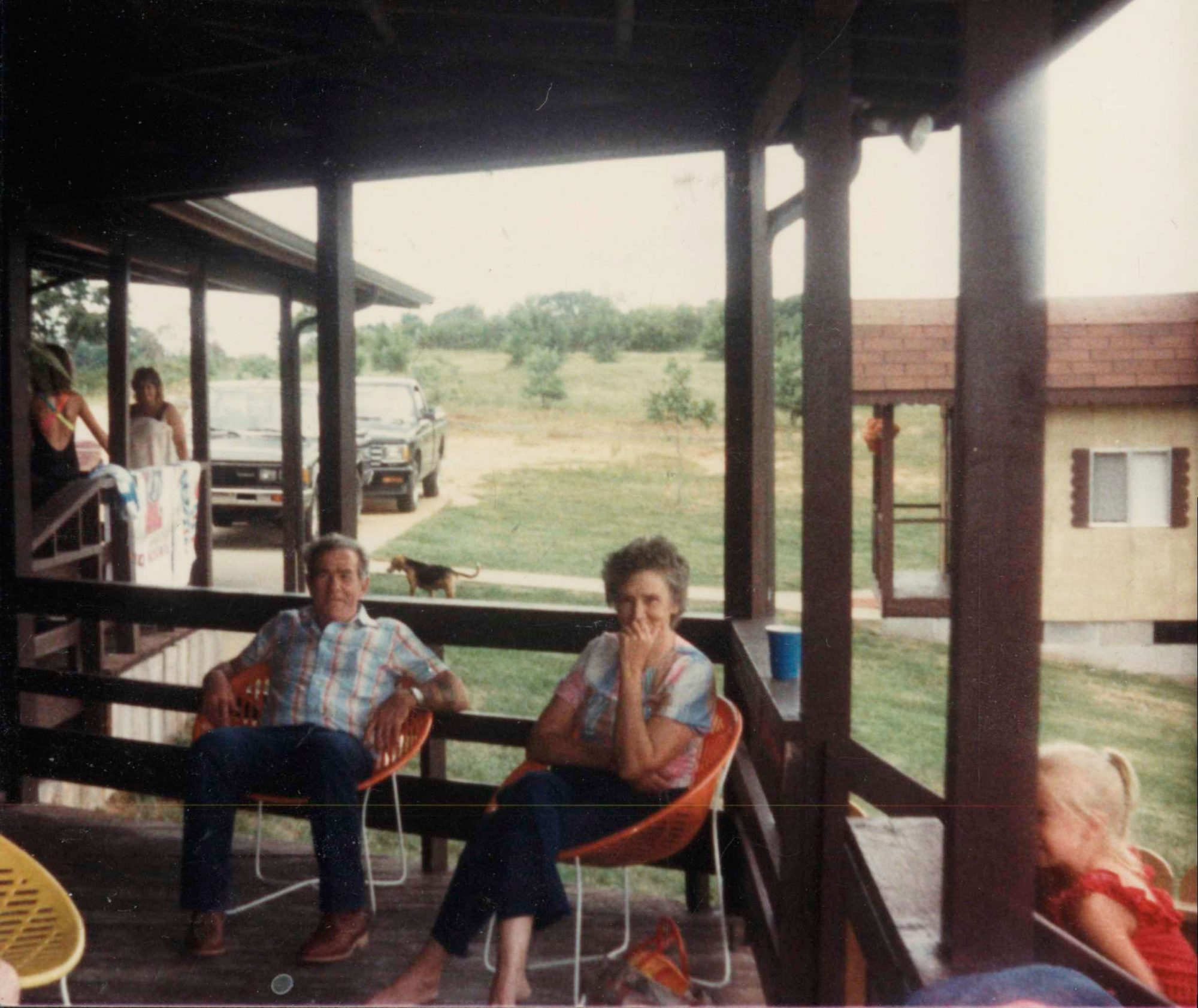 Writer Caleb Johnson's PawPaw and Granny on the porch of a relative's house in July 1985