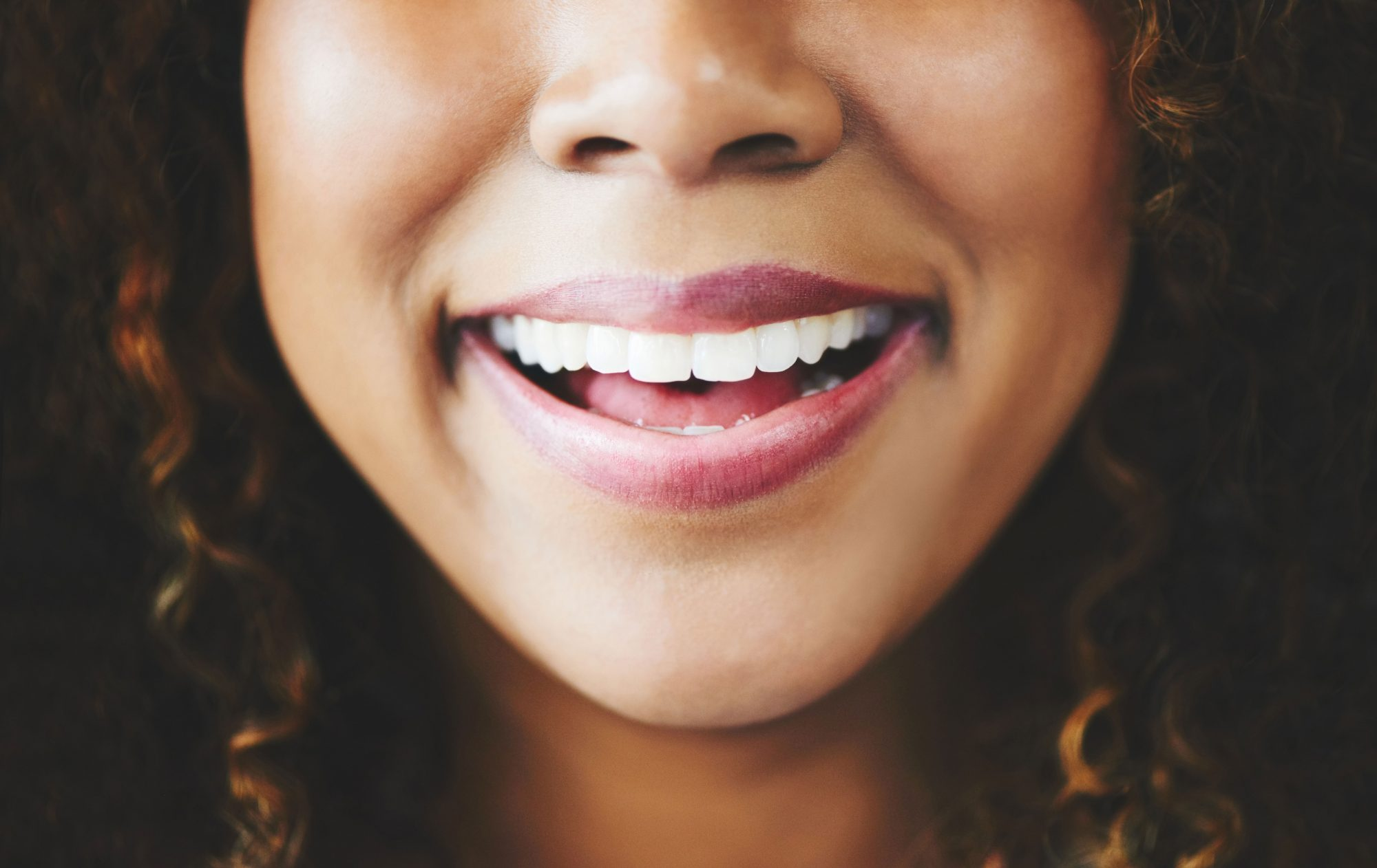Woman Smiling with Pink Lipstick