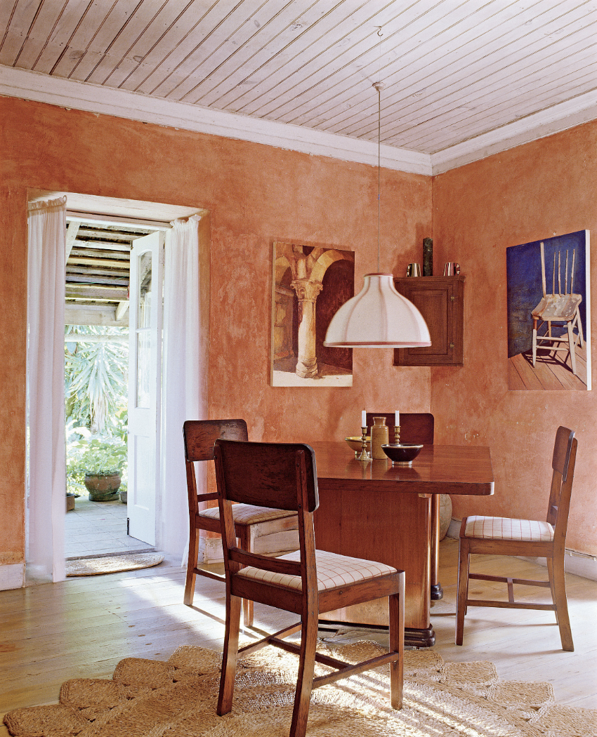Dining Room with Bold Color and Paintings