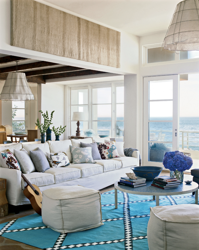 Beach Living Room with Bright Blue Rug