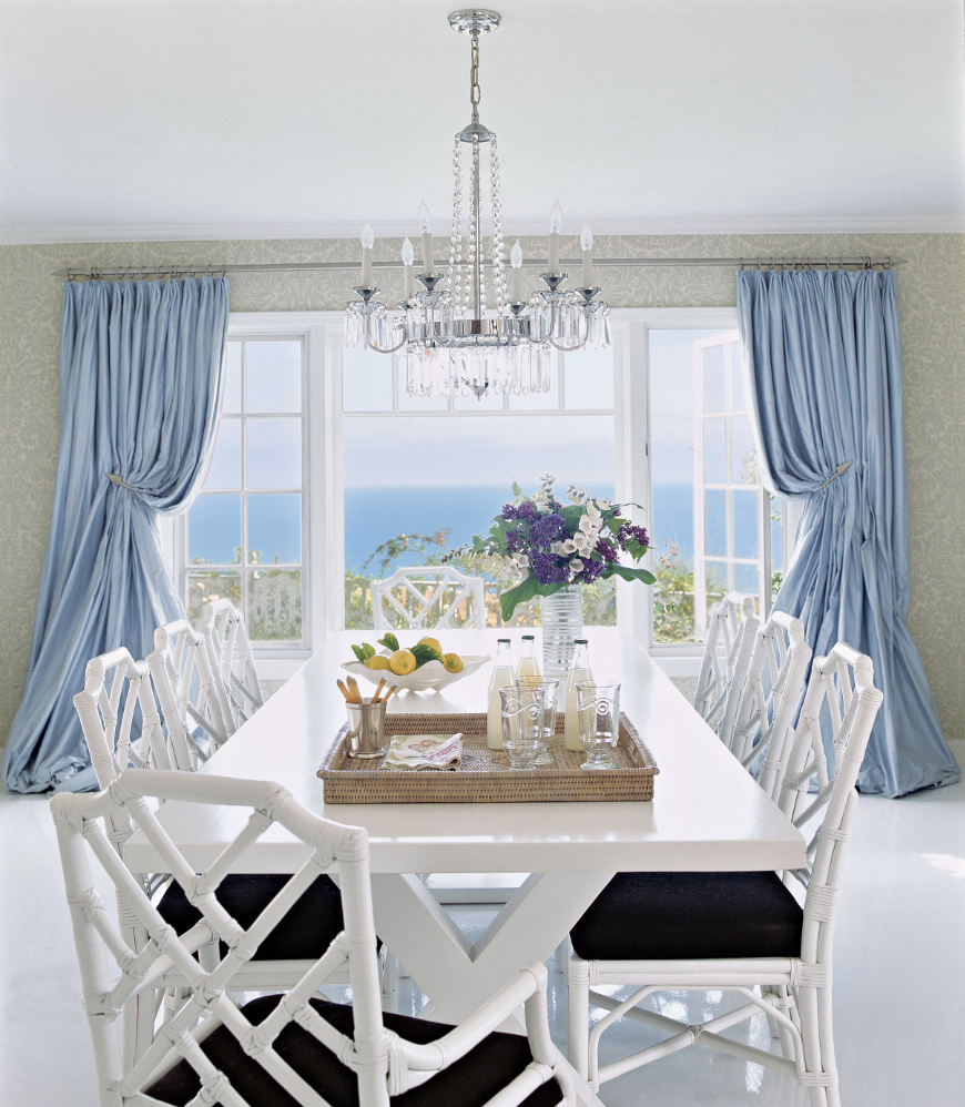 White Dining Room with Blue Curtains