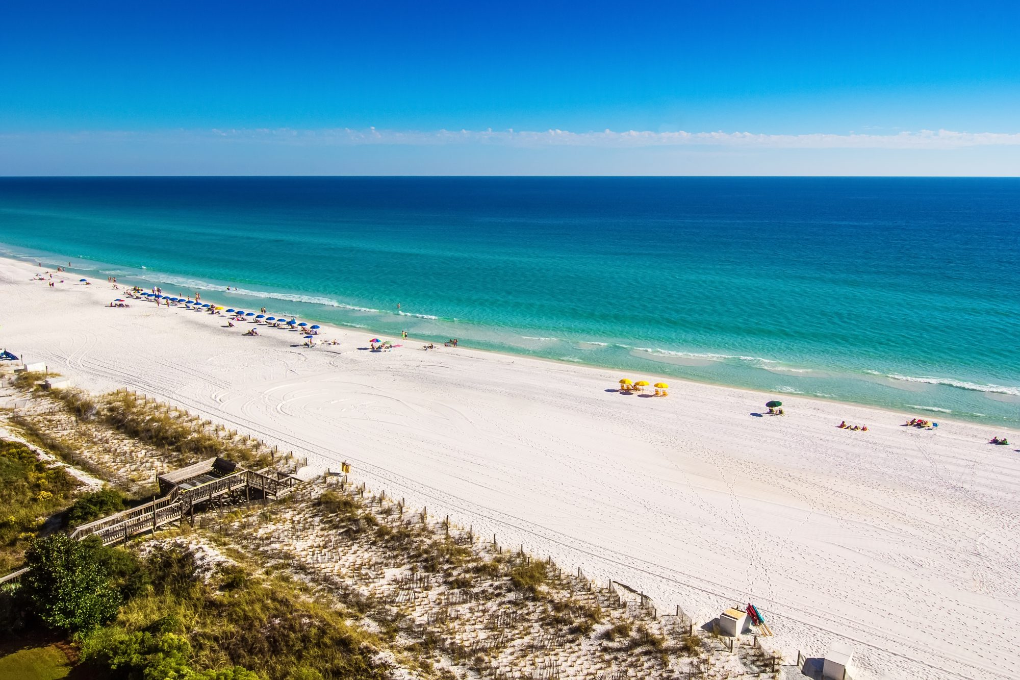 Destin, Florida, USA - Oct. 24, 2014: Beach goers enjoy the white sandy beaches and emerald blue waters of the panhandle in Destin, Florida. Originating as a small fishing village, it is now a popular tourist destination.