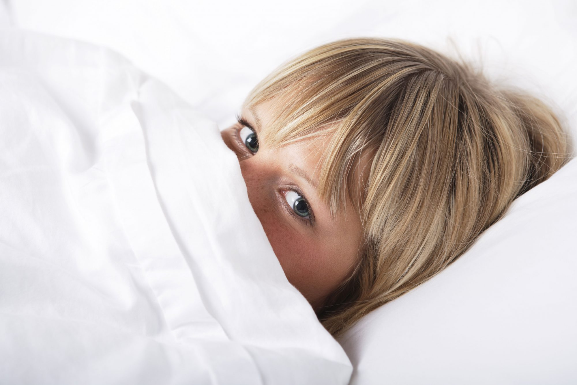 Woman Hiding Under Sheets