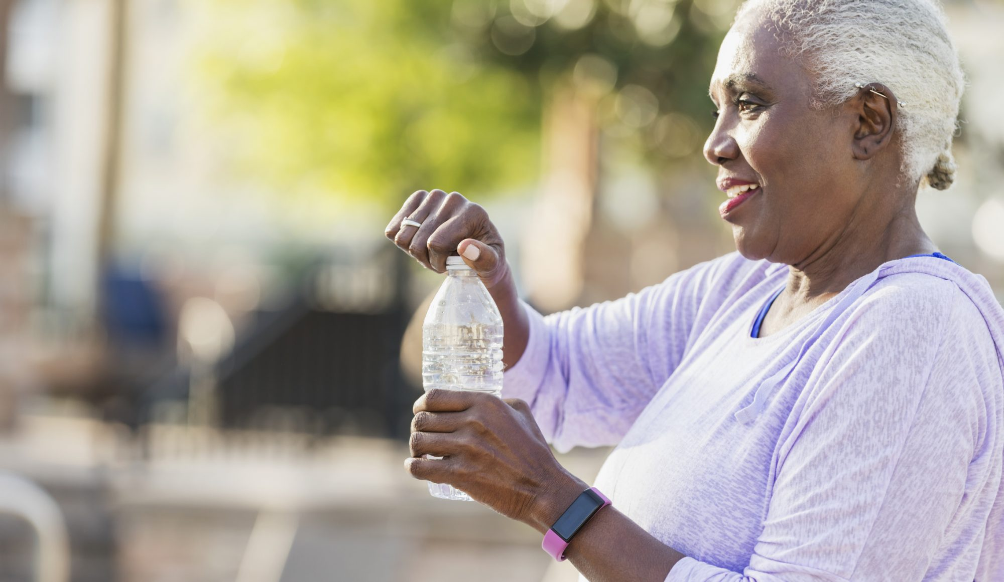 Older Woman Opening Bottle of Water