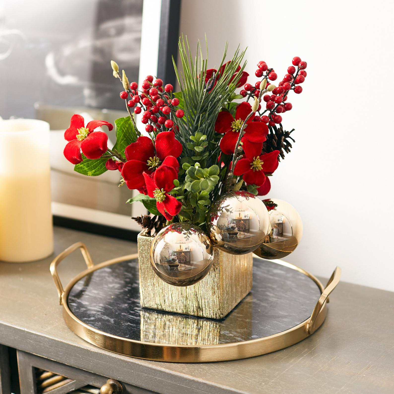 Get a jumpstart on your holiday floral arrangement by investing in a high-quality, lifelike faux. This elegant find features red velvet flowers, a metallic ceramic vase and gold ornaments for a especially festive touch.Buy it: $89; etsy.com