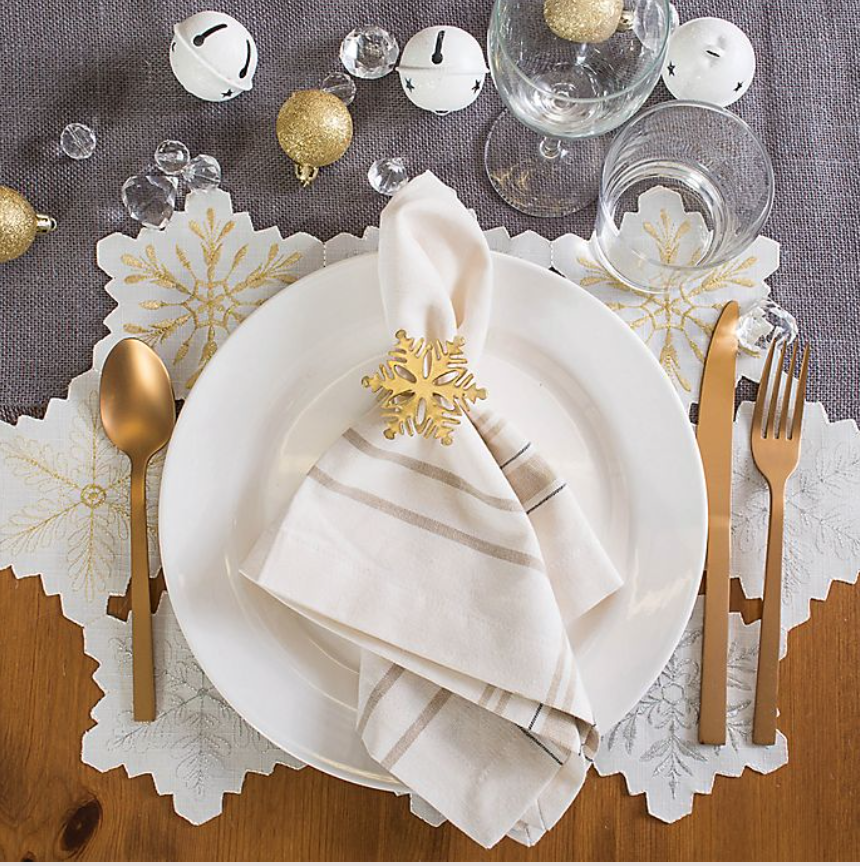 Holiday tables need no other frills when they're decorated with these festive placemats. Charming snowflake cutouts and gilded accents make them as much the star of the Christmas dinner as the food.Buy it: $33 for four; bedbathandbeyond.com