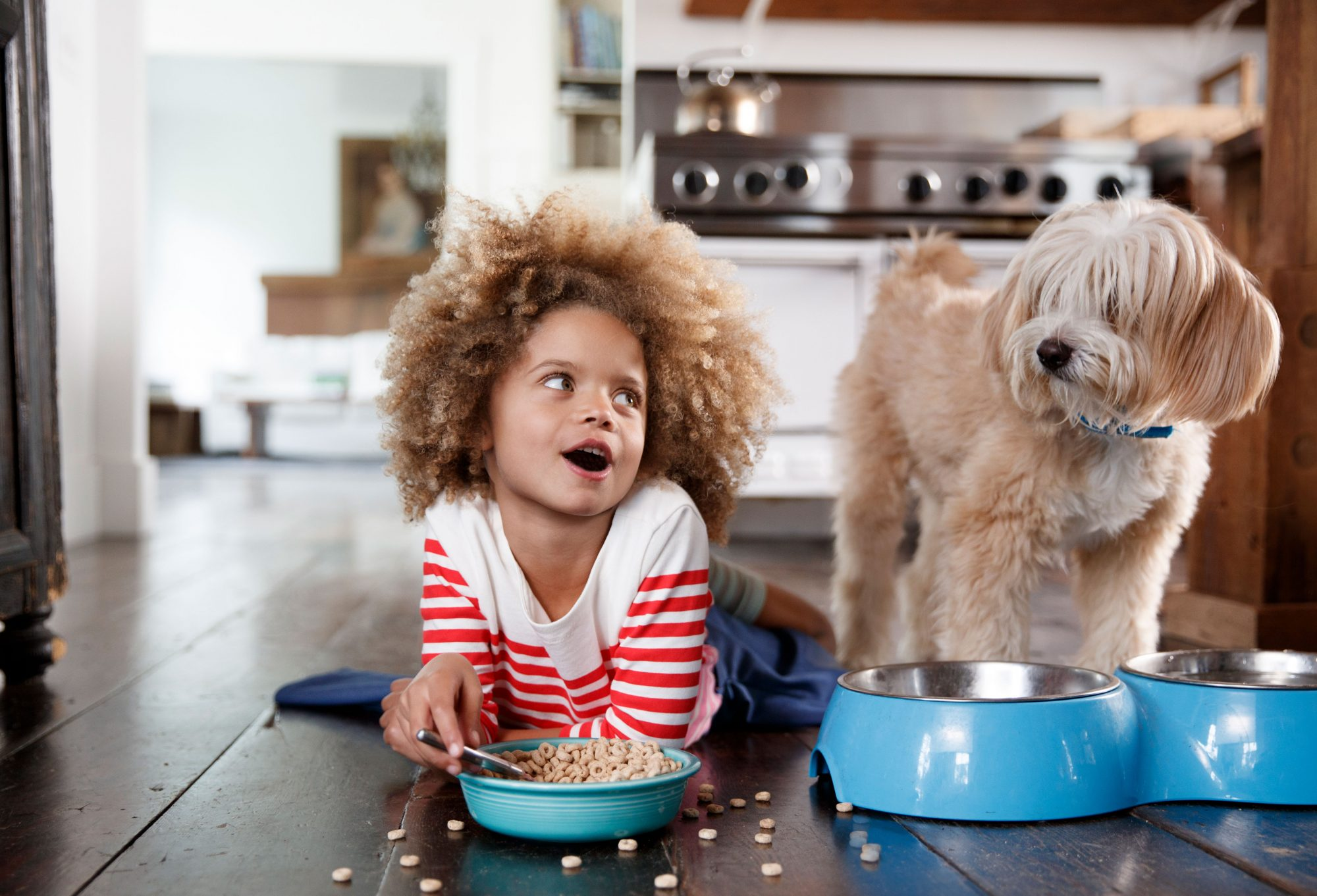 Girl with Dog on Kitchen Floor