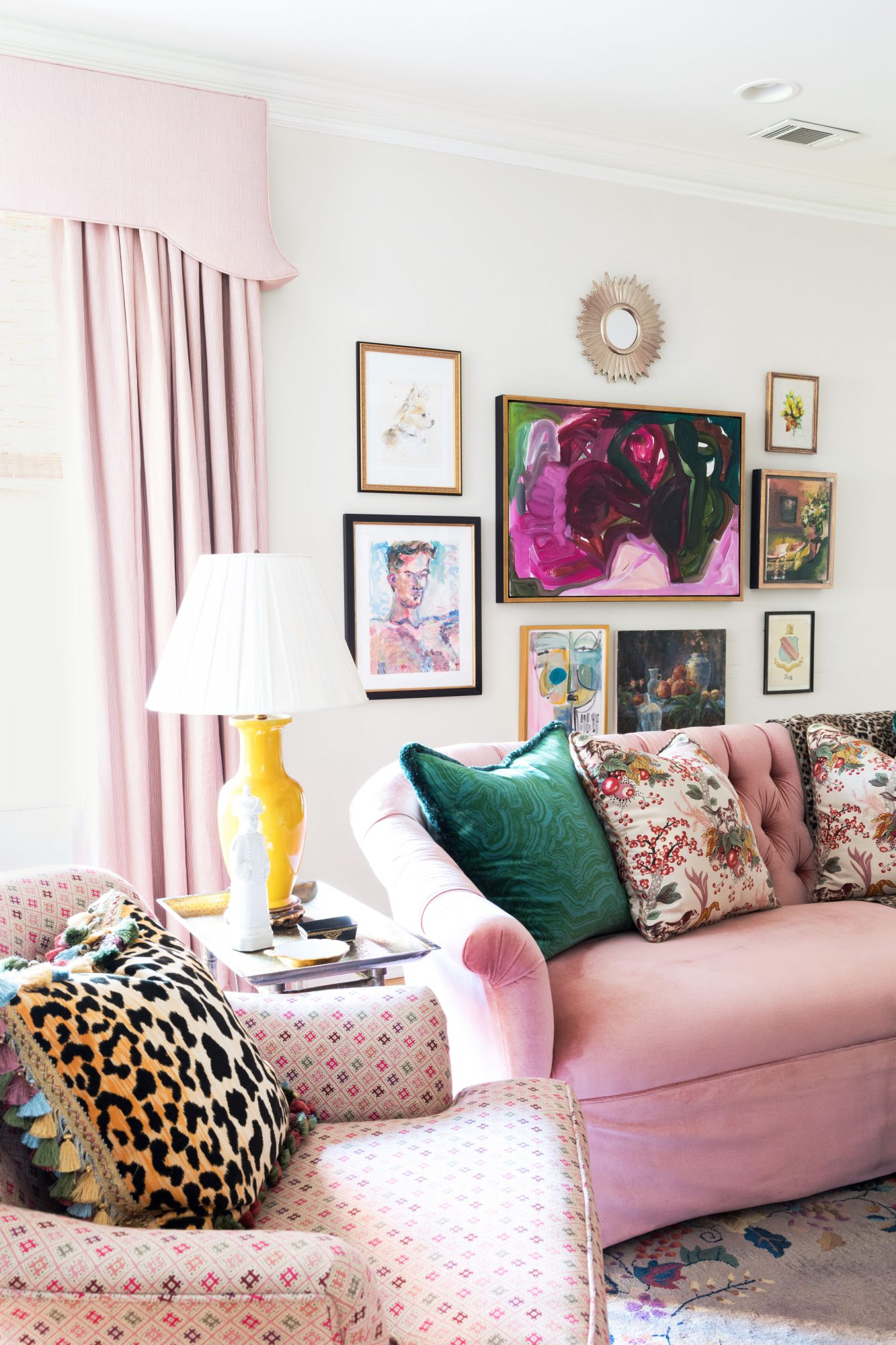 White Wall Living Room with Pink Sofa and Gallery Wall of Art