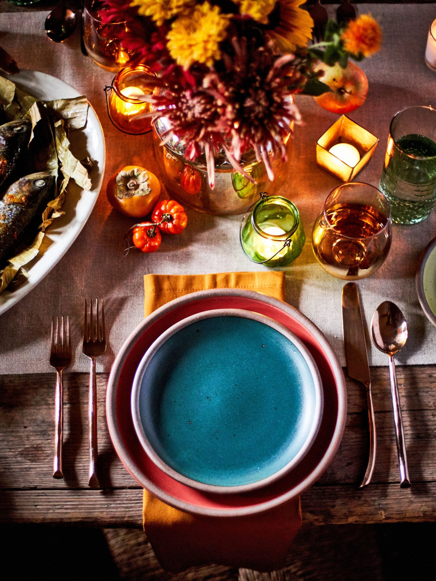 Orange, Red and Teal Outdoor Table Setting for Fall
