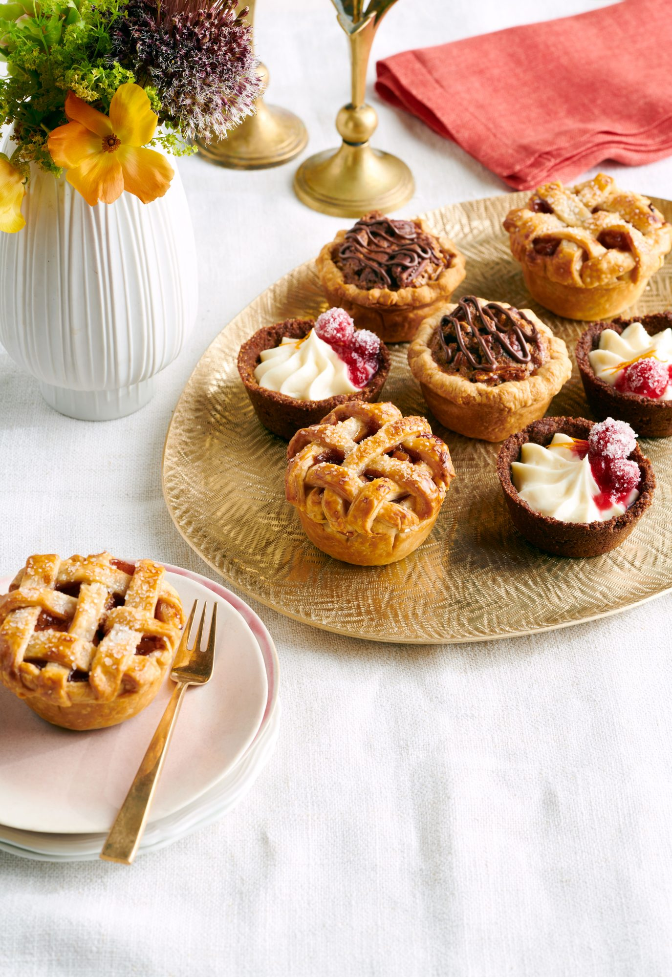 Mini Apple-Cinnamon Pies, Mini Cranberry-Cheesecake Pies, and Mini Chocolate-Pecan Pies