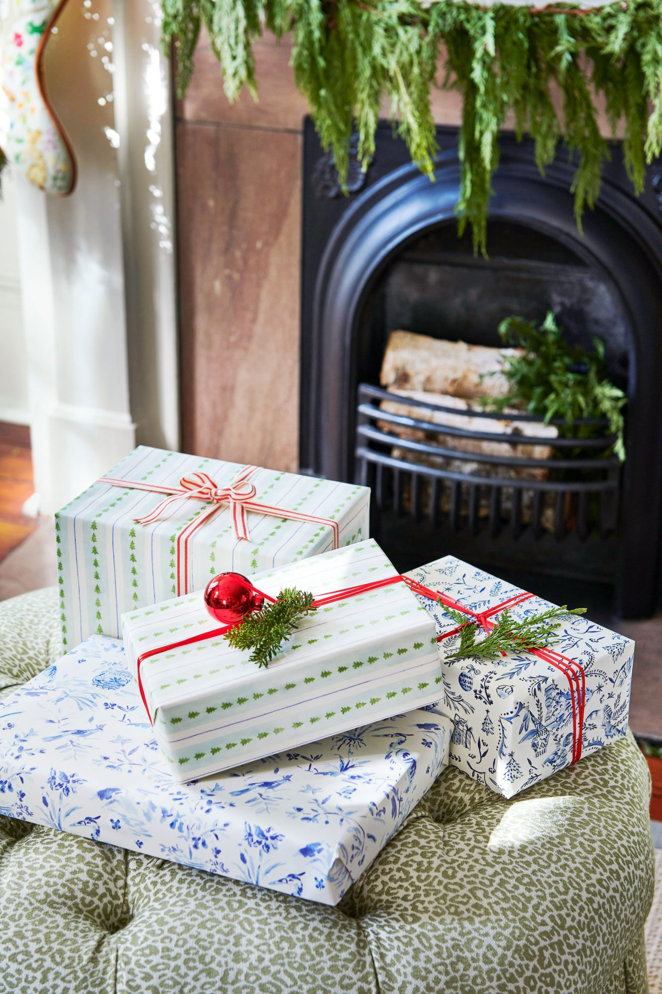 Christmas presents wrapped in green and blue paper with red ribbon.