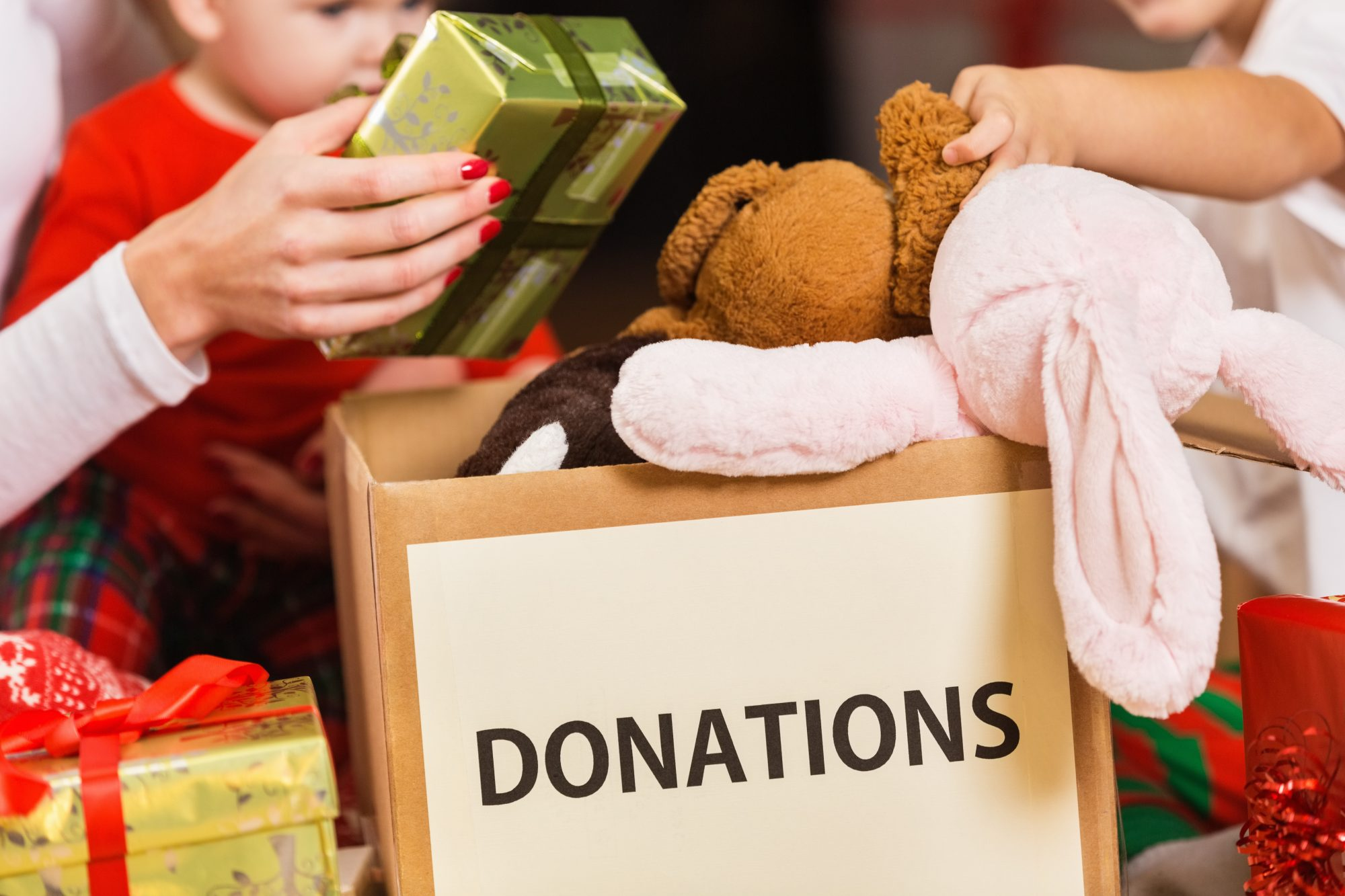Family Donating Gifts