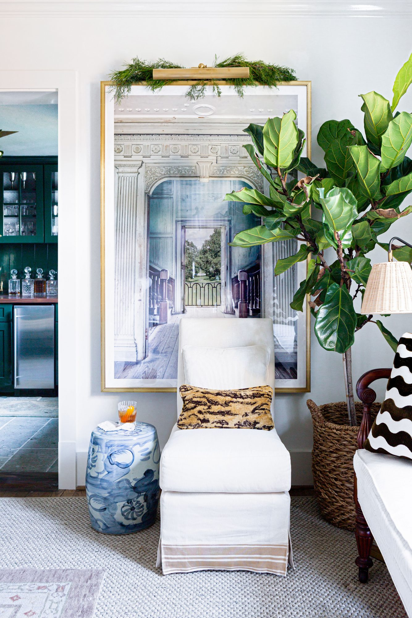 Home vignette with traditional furniture, fiddle-leaf fig tree, and modern photography art.