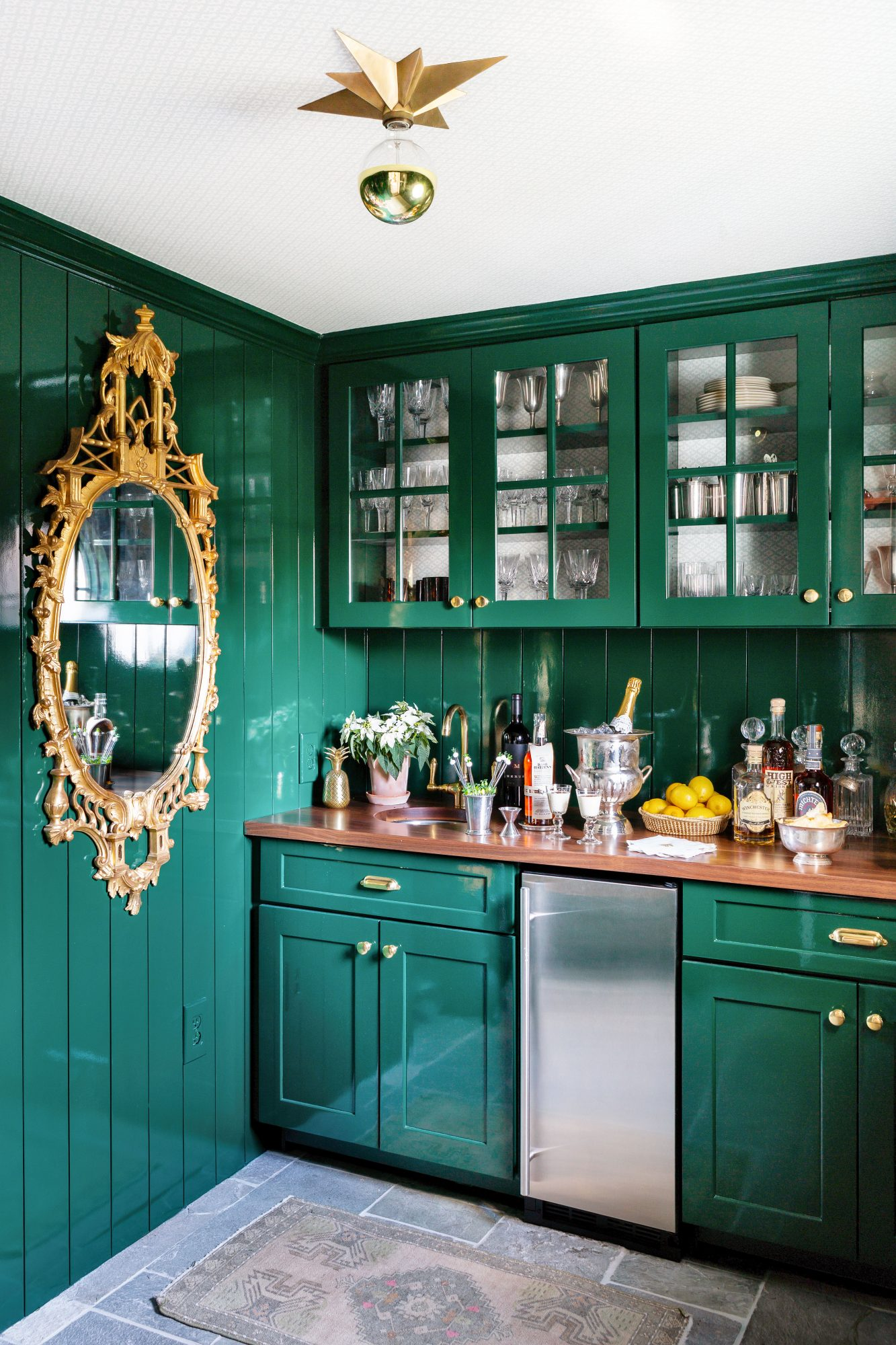 Bar room with green lacquered walls and cabinetry