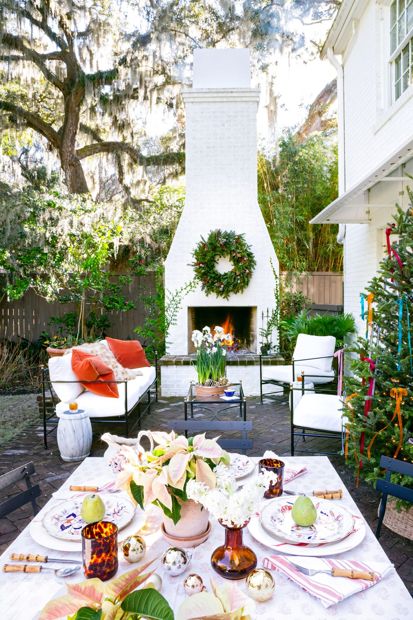 Backyard courtyard with outdoor fireplace and Christmas tree