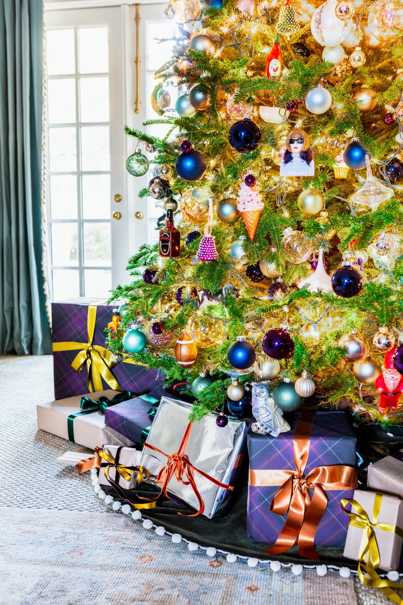 Jewel tone Christmas tree ornaments and packages