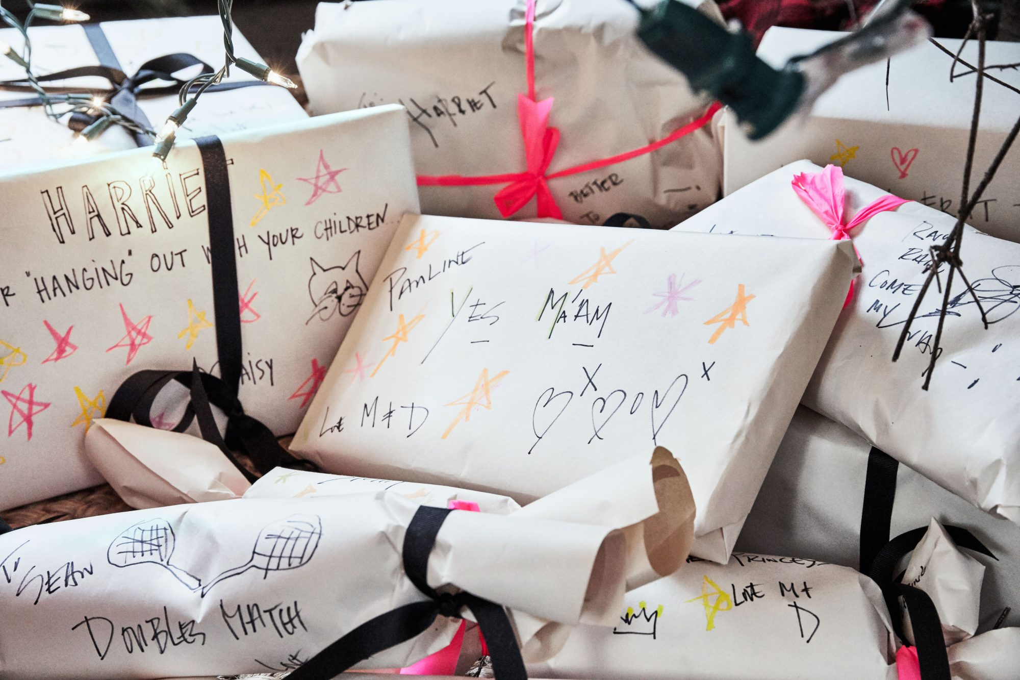 Mashburn Family Christmas Packages wrapped with paper and individually decorated