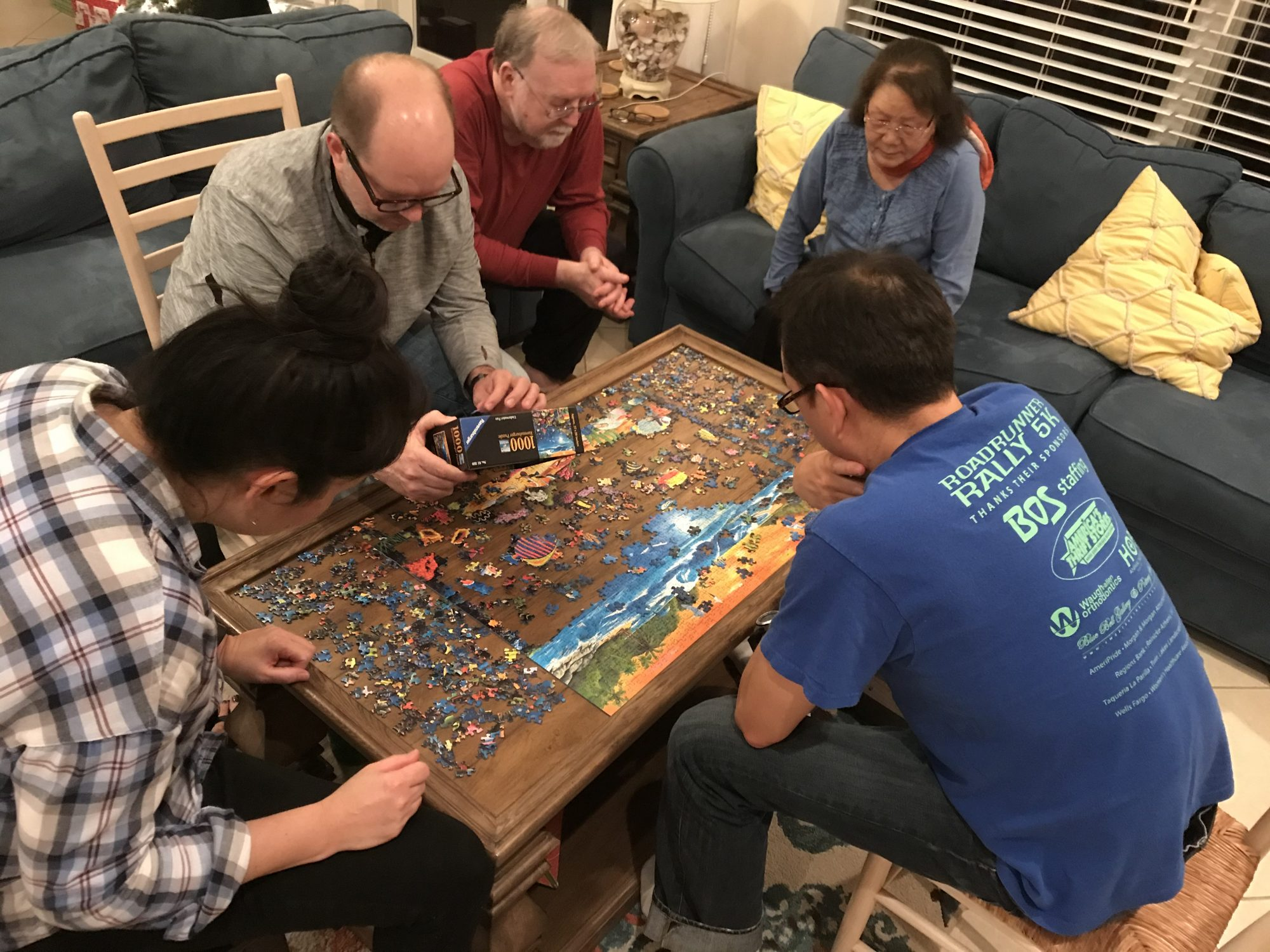 Ann Pittman and her family working on a puzzle at Thanksgiving