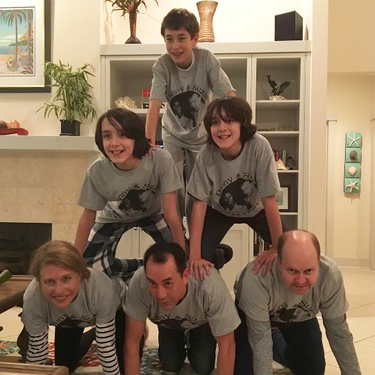 Ann Pittman's family doing a pyramid at a holiday celebration