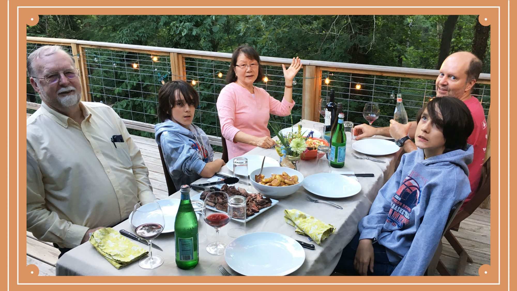 Ann Pittman and her family enjoying dinner outside