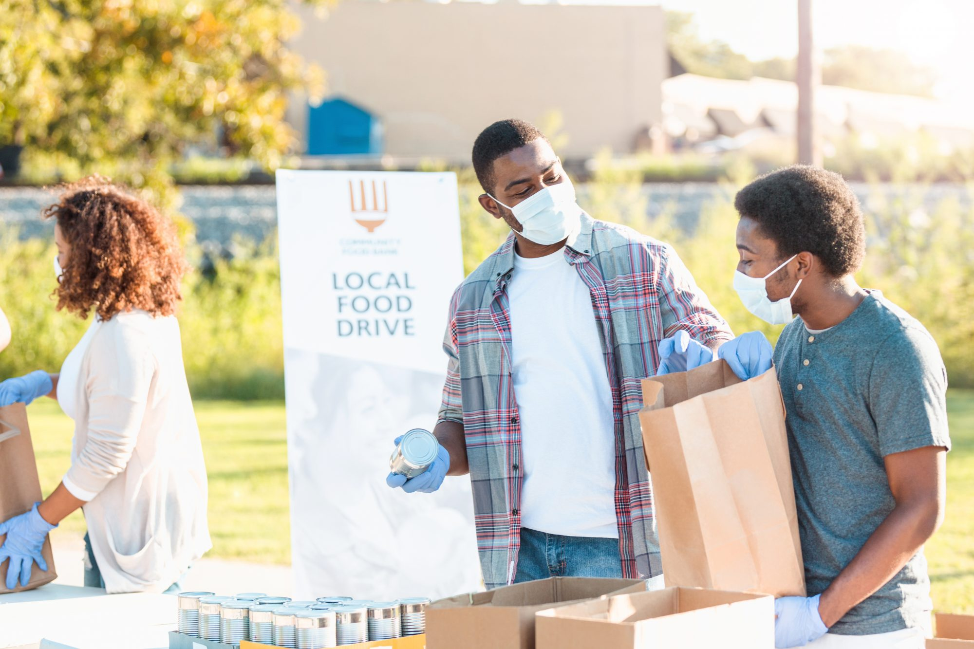 Father and son spend time together at food drive