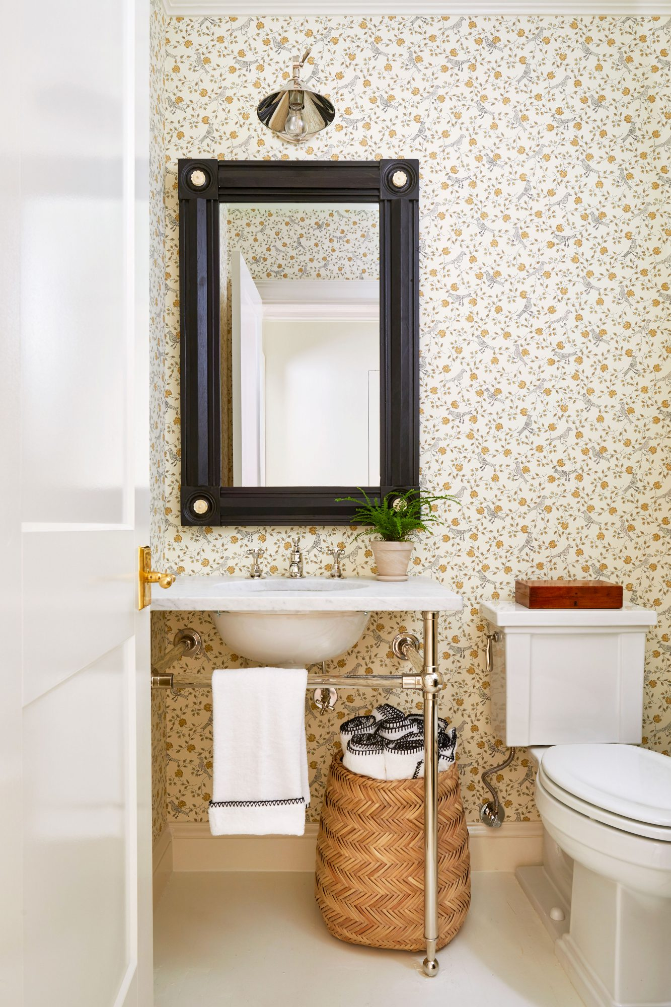 Neutral powder room with black accents