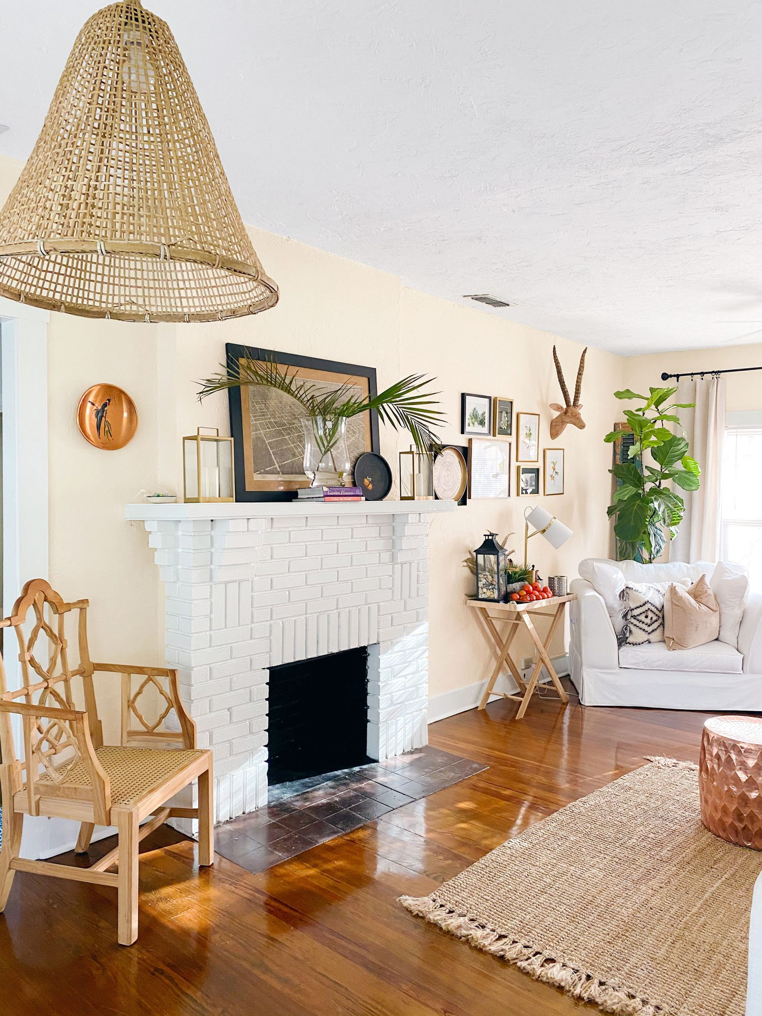 Ebonee Mashae's living room with painted white brick fireplace and textured accessories