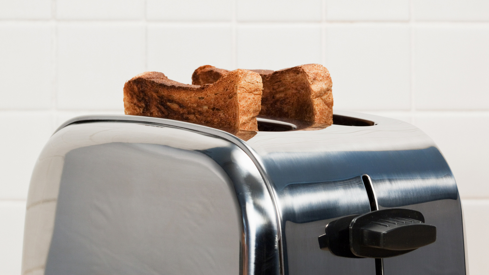 There's a Hidden Crumb Tray Under Your Toaster That You're Probably Not  Cleaning | Southern Living