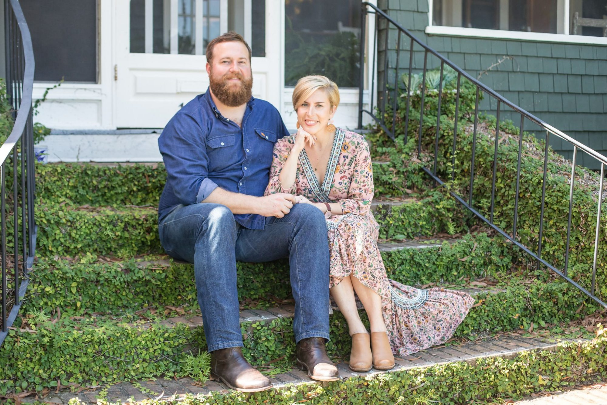 Ben and Erin Napier sitting on steps