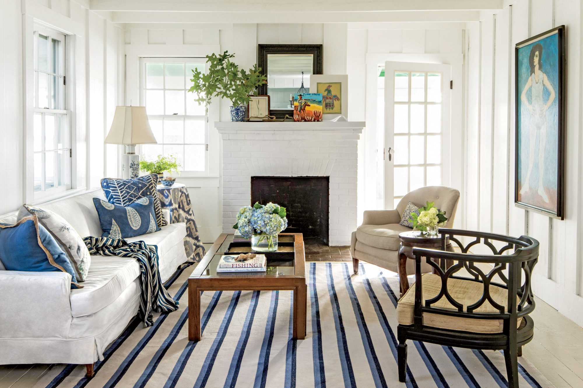 River House living room with white walls and blue accents