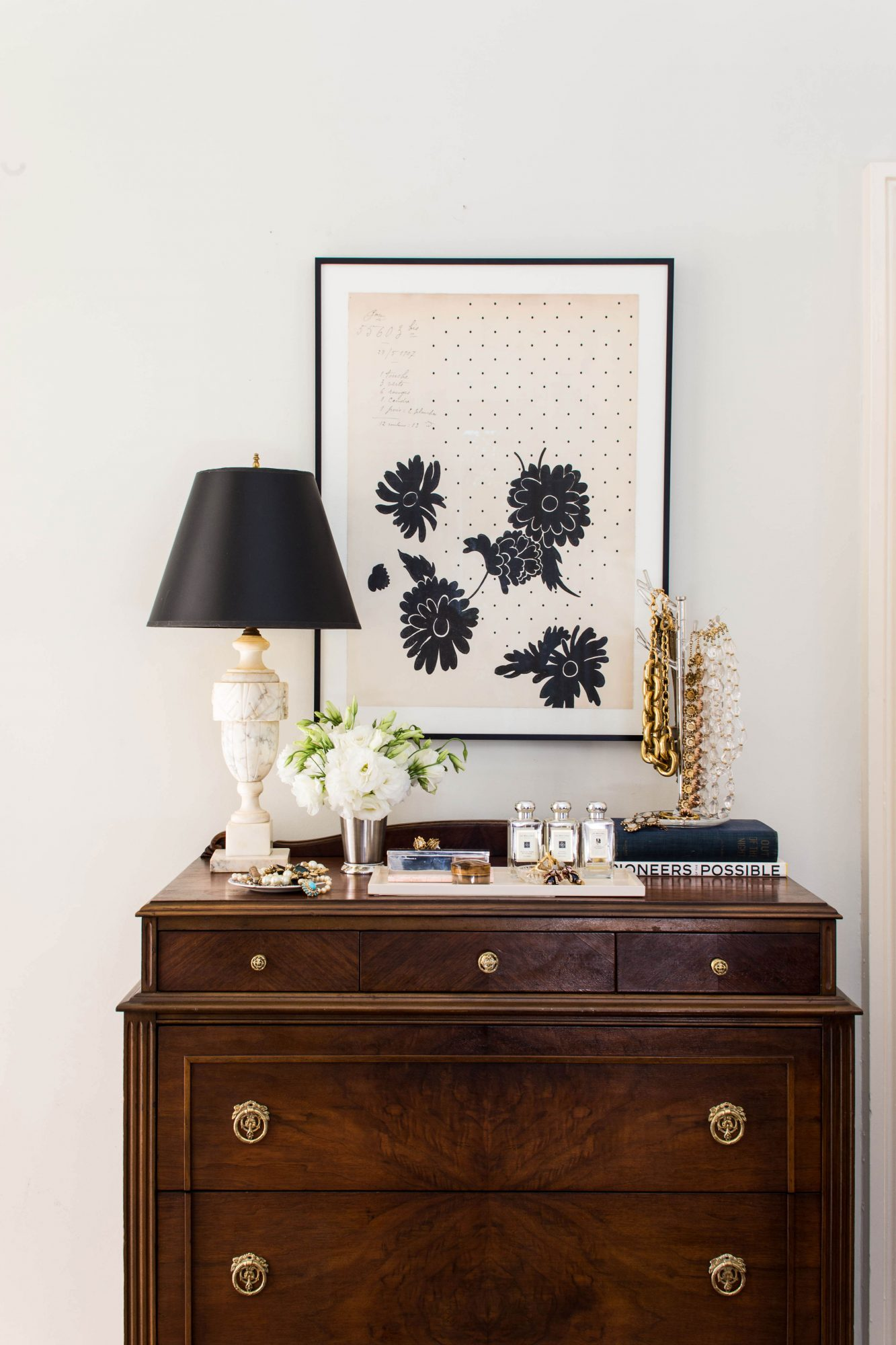 Antique dresser and vanity space with black and white accessories