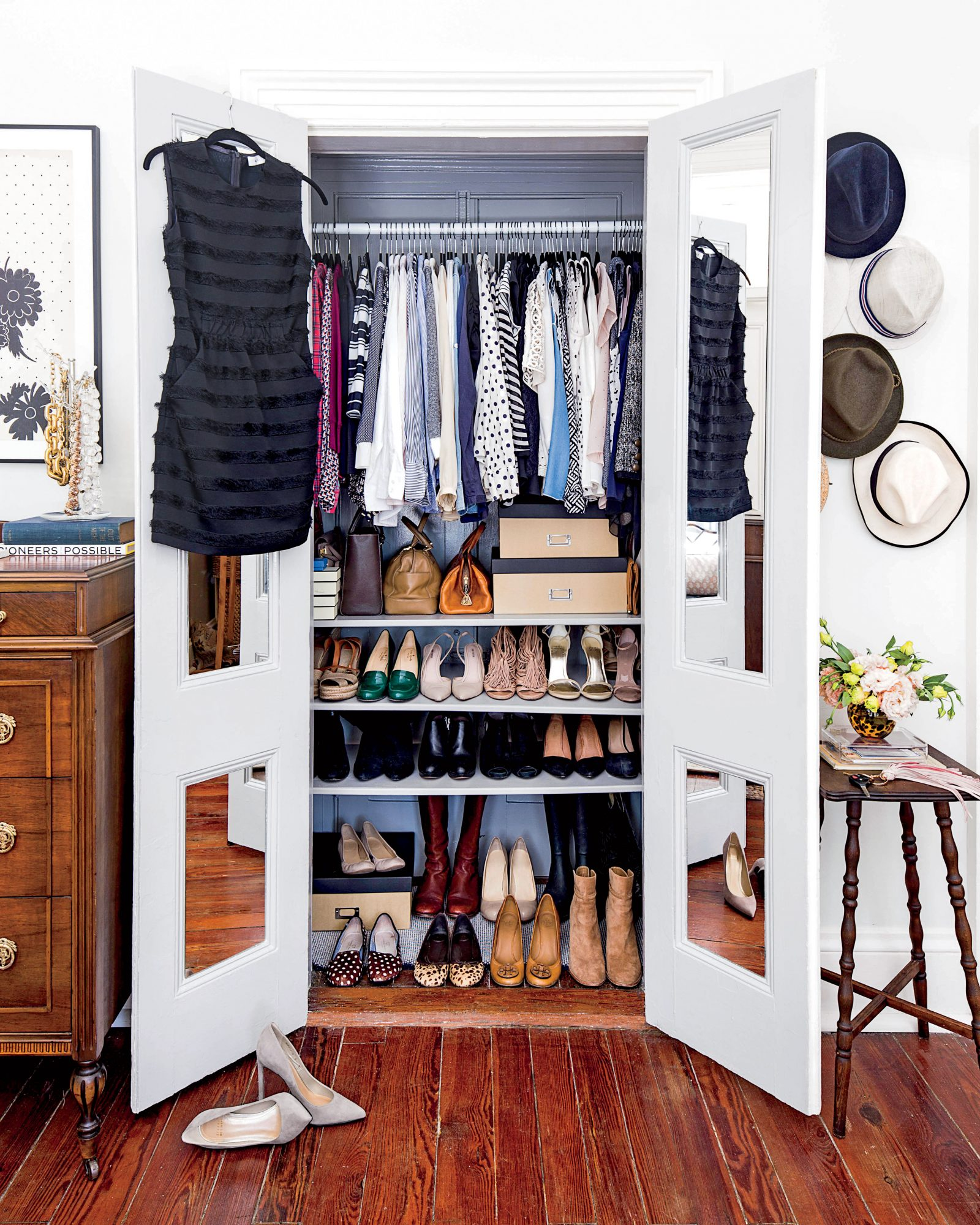 Small apartment closet storage for shoes and tops.