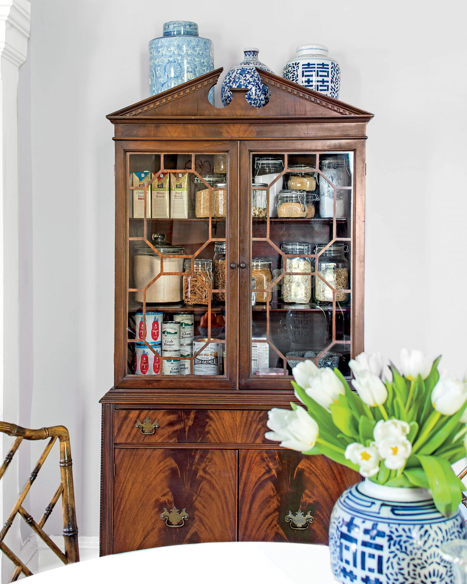 Antique china cabinet in kitchen working as pantry storage