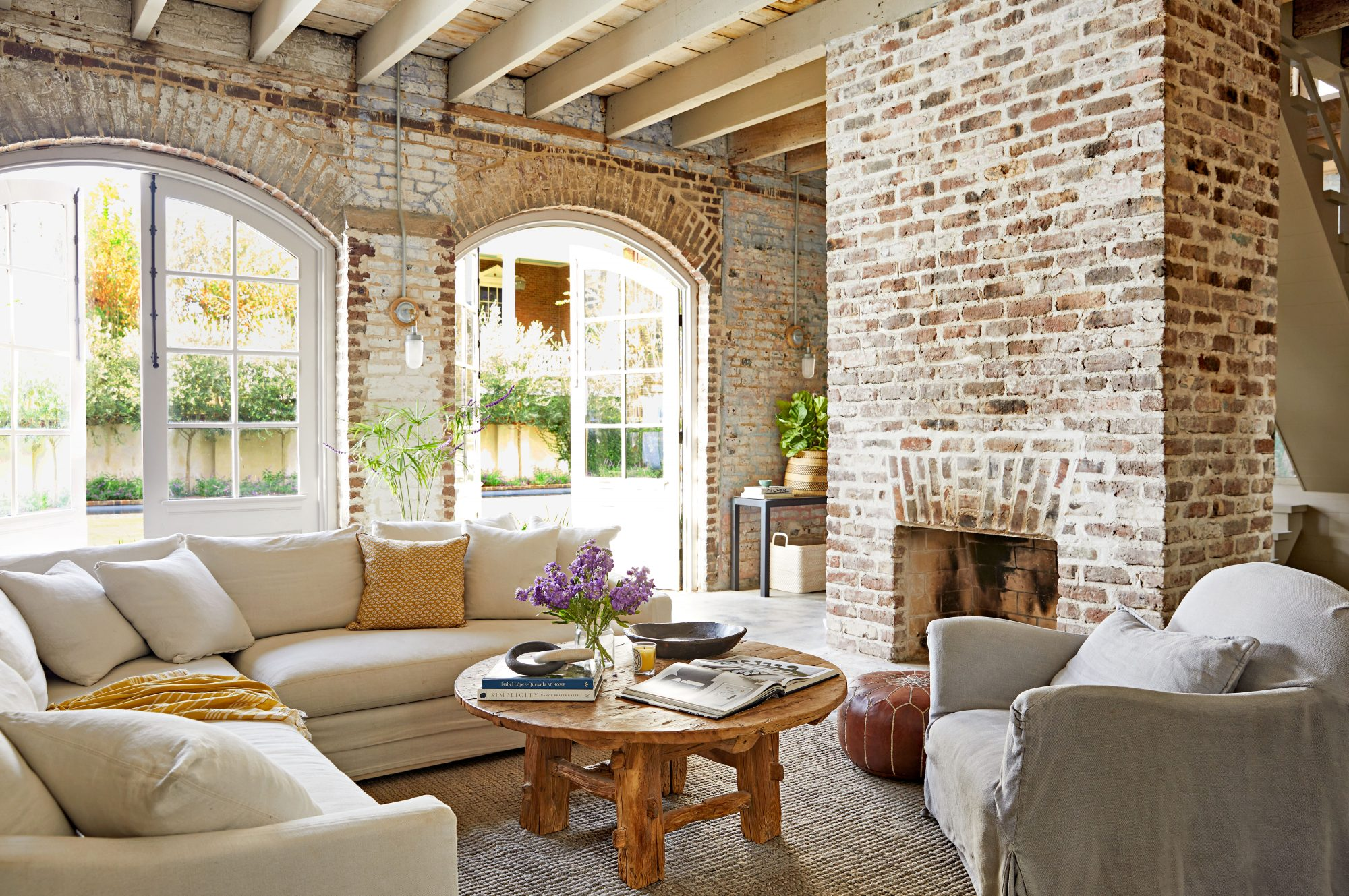 Brick walled living room in historic carriage house