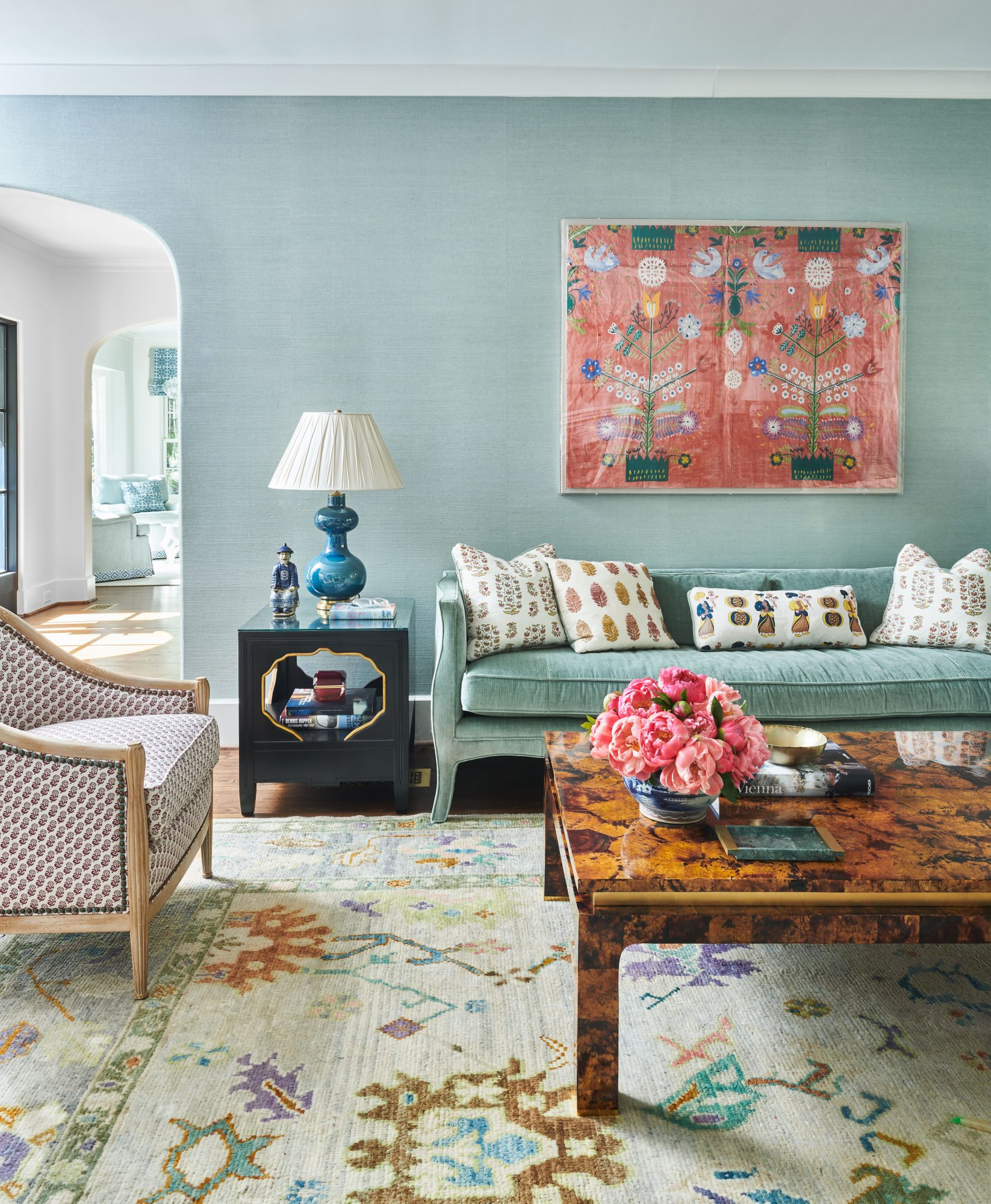 Teal grasscloth walls with accents of pink