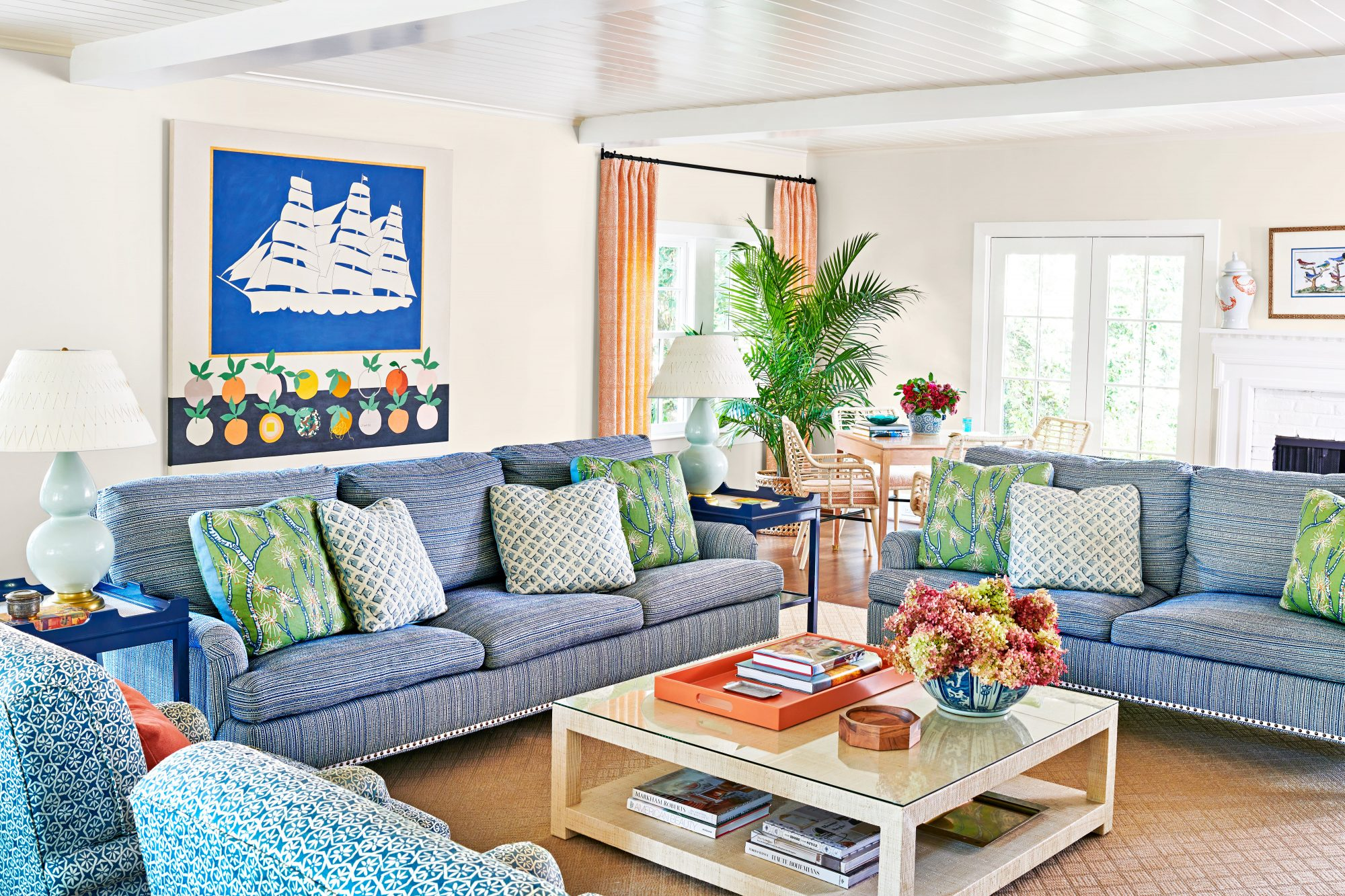 Family room with white walls and bold color furniture