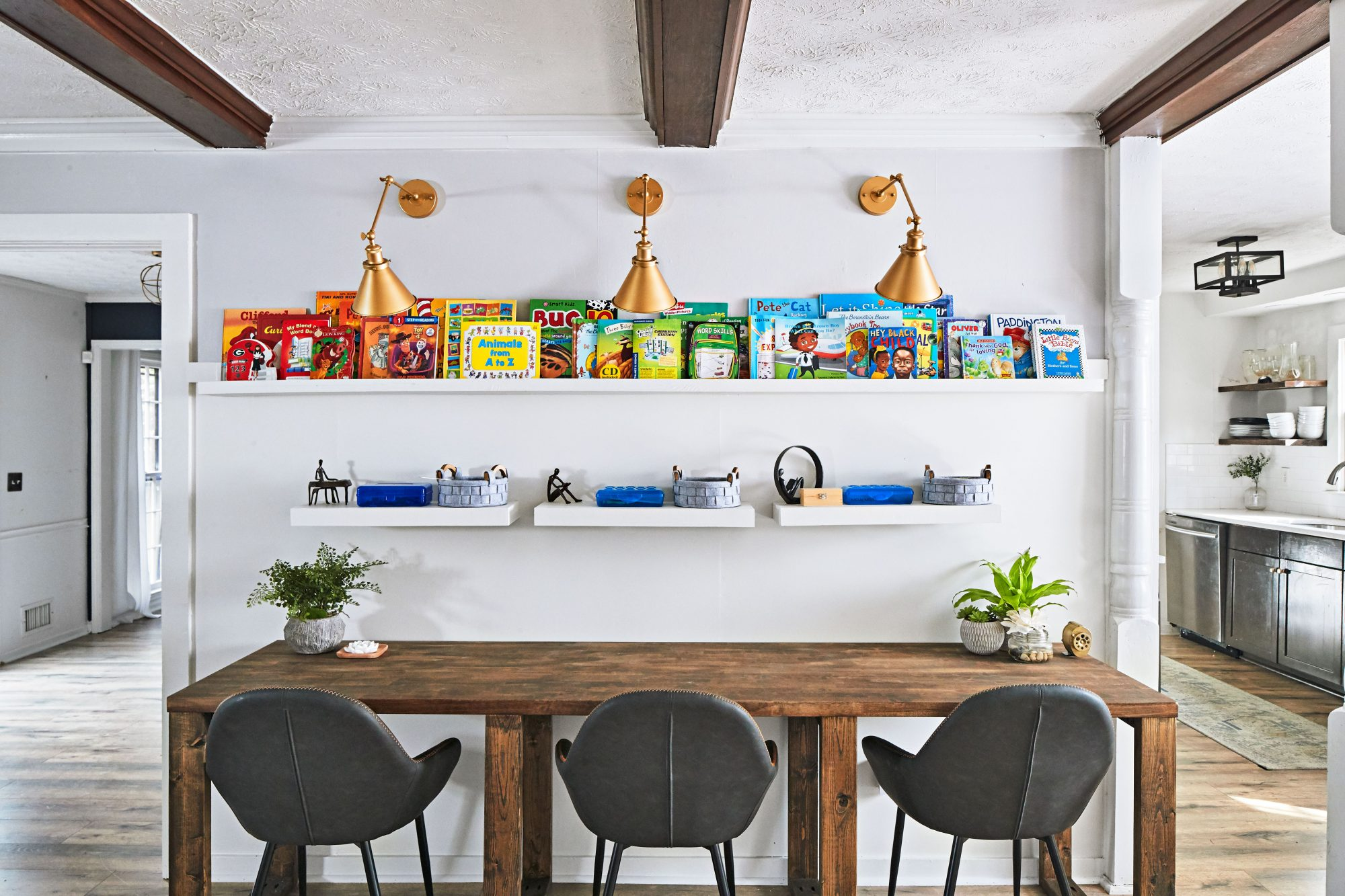 Home Schooling zone with built in desks for three and floating shelves