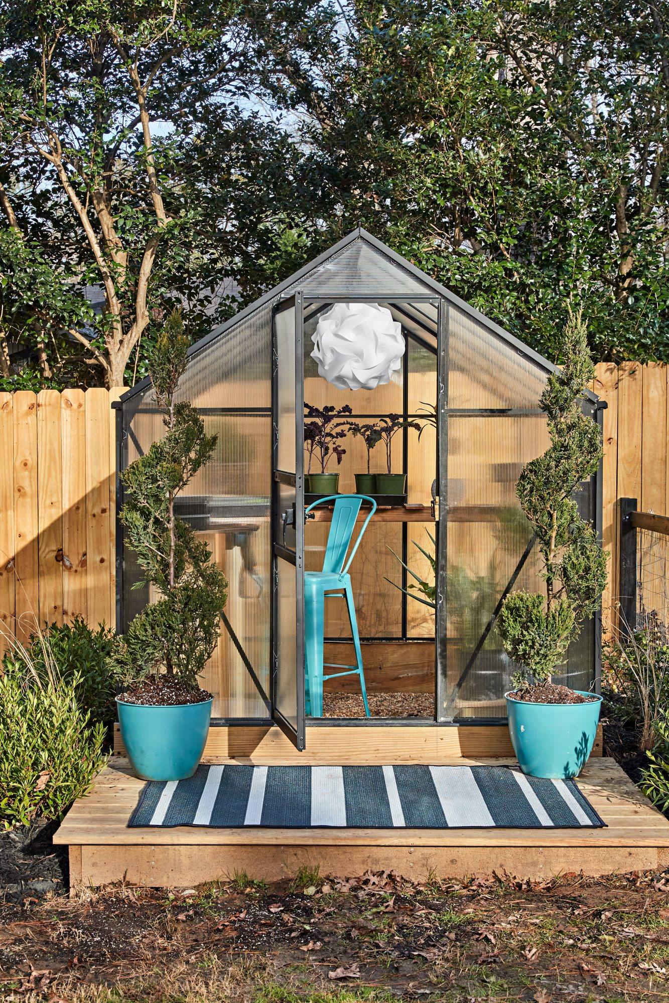 Backyard Greenhouse with teal accents