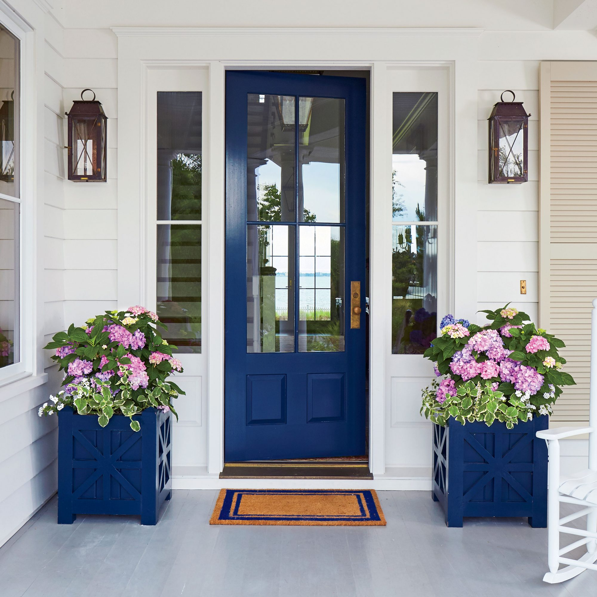Blue Front Door with Matching Containers with Hydrangeas