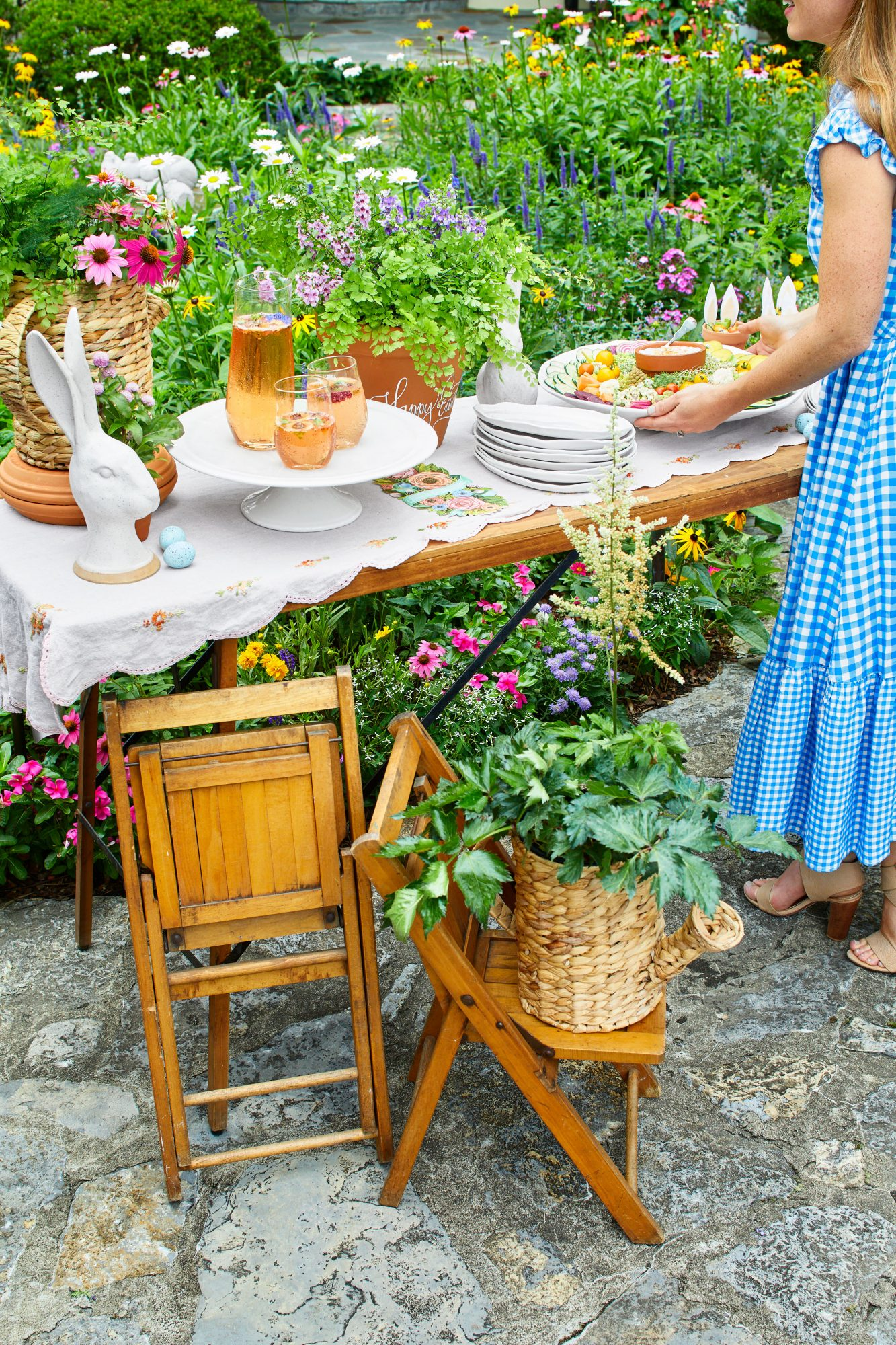 Garden themed Easter party with potted plants, vintage linens, and Easter accents