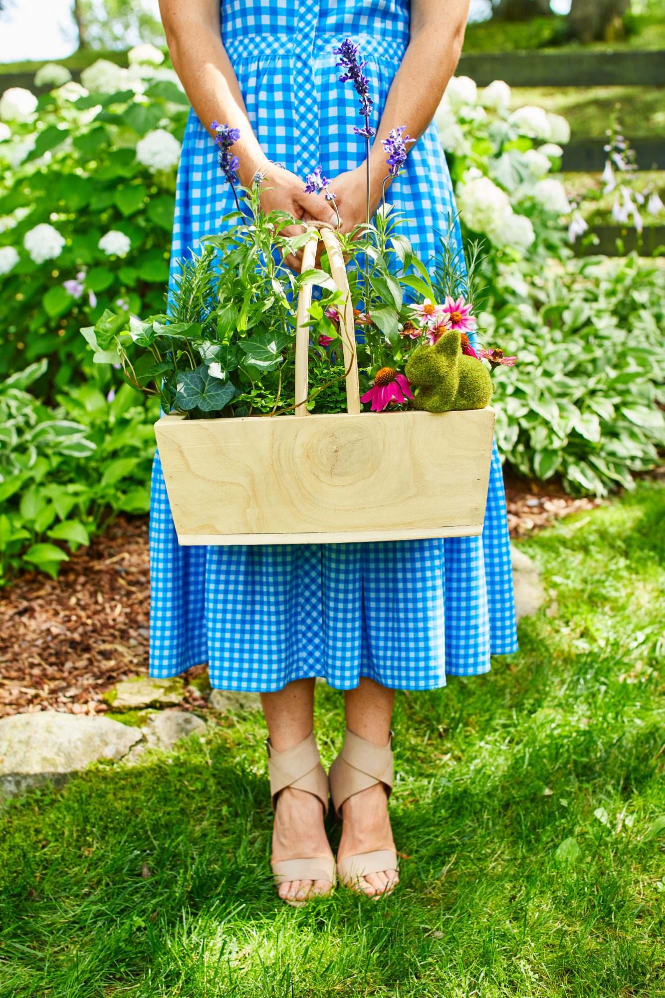 Katie Jacobs holding basket with flowers
