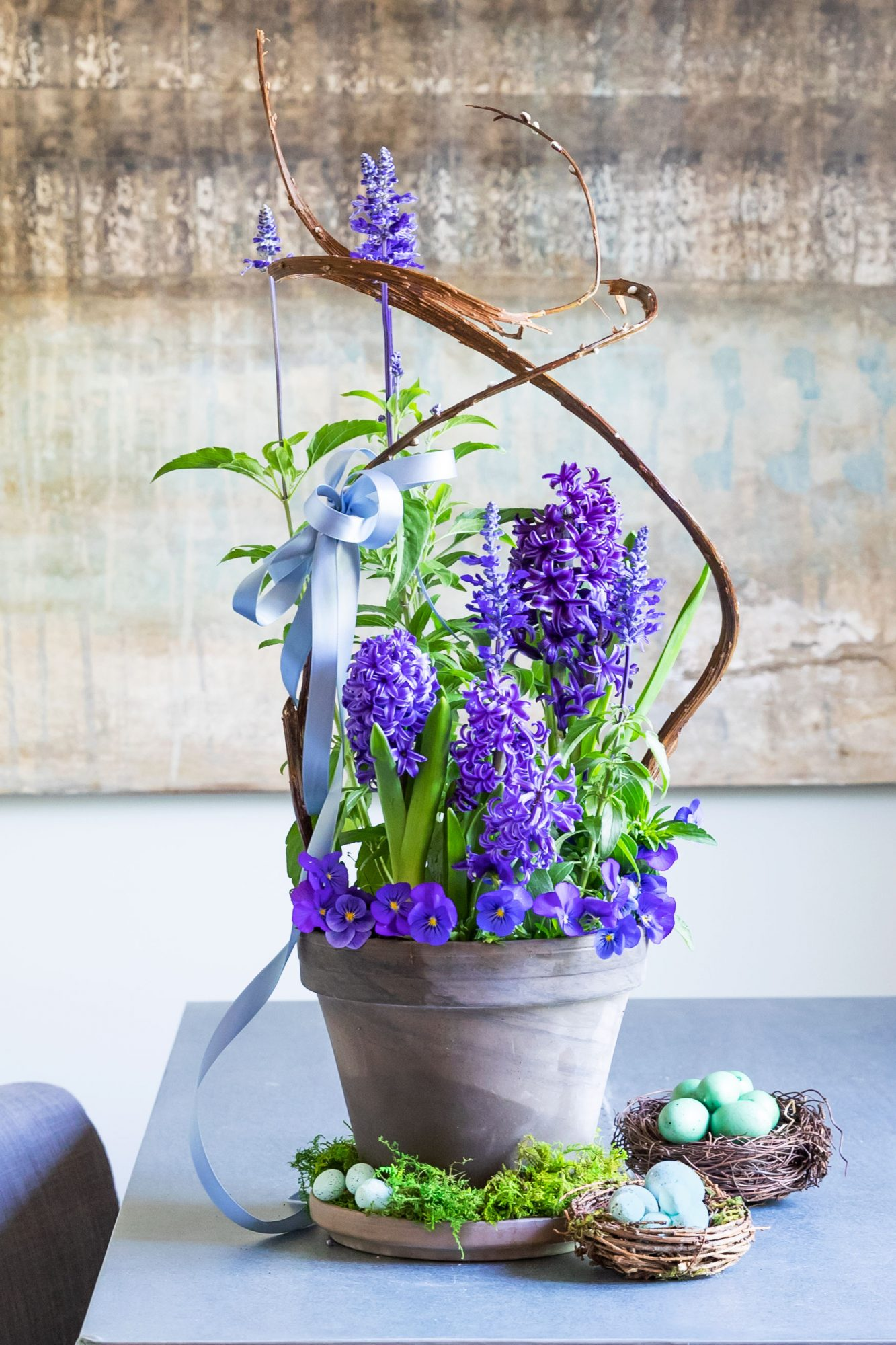 Potted purple hyacinths and violas for Easter growing centerpiece