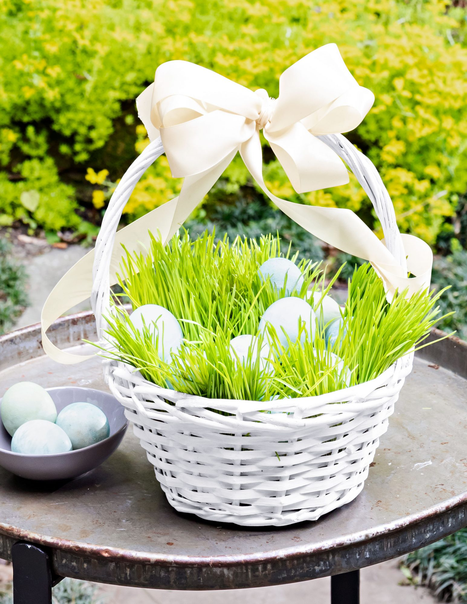 Easter basket with live wheat grass and dyed Easter eggs