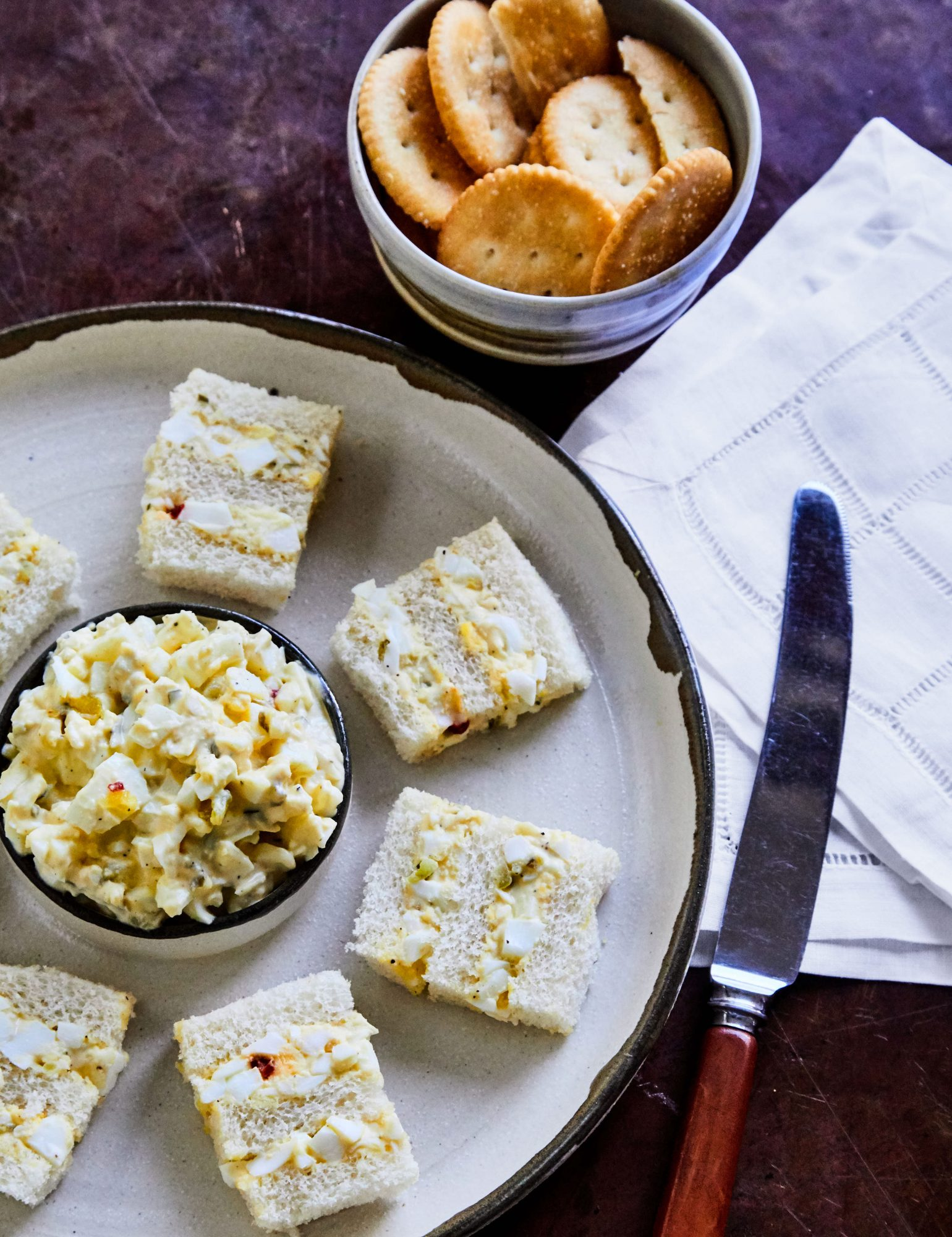 Egg salad finger sandwiches and option for dipping