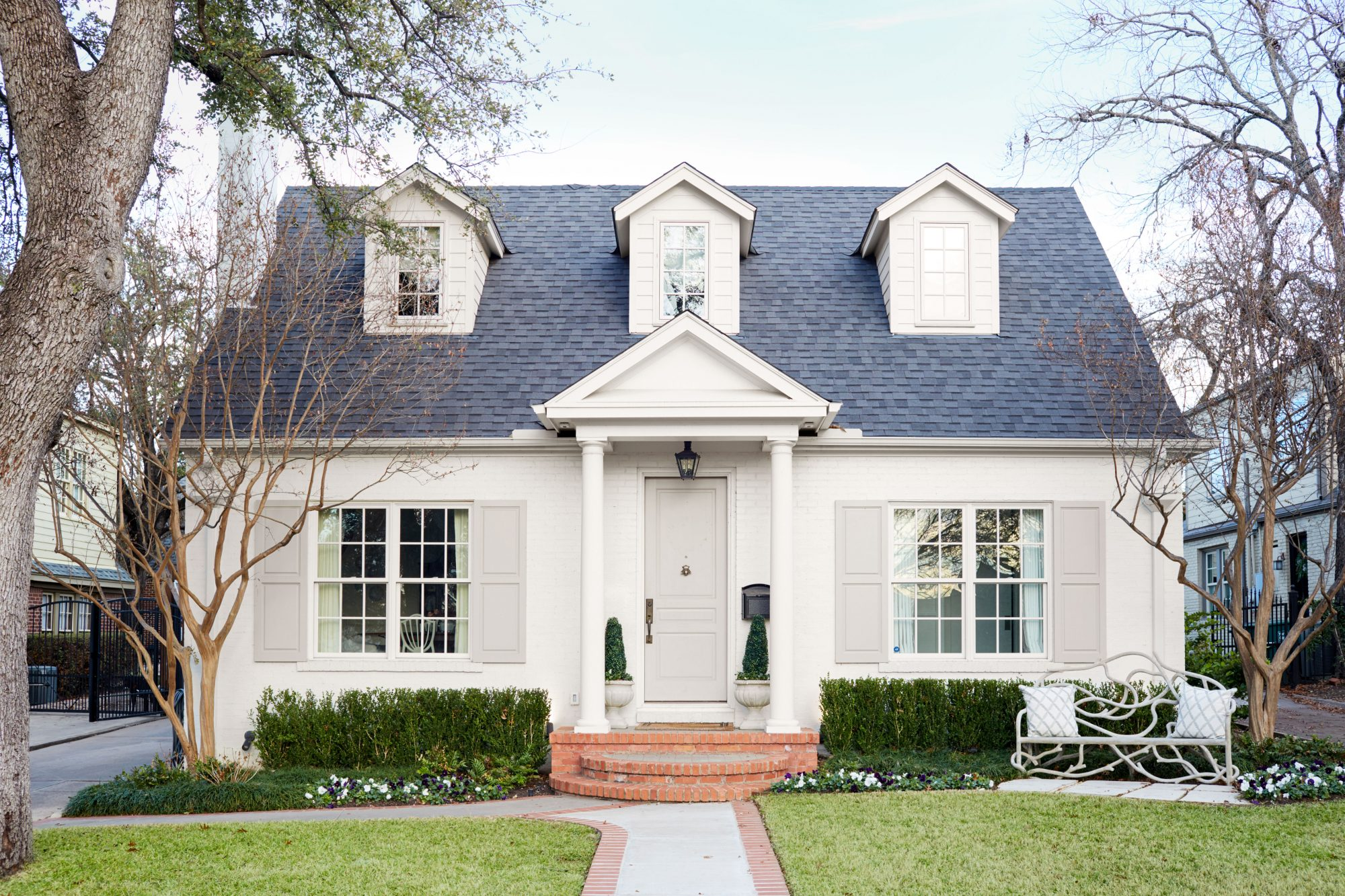 1935 Colonial home exterior with off-white color scheme